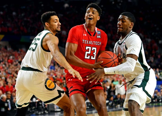 Apr 6, 2019; Minneapolis, MN, USA; Texas Tech Red Raiders guard Jarrett Culver (23) drives to the basket against Michigan State Spartans forward Aaron Henry (11) and forward Kenny Goins (25) during the first half in the semifinals of the 2019 men's Final Four at US Bank Stadium. Mandatory Credit: Bob Donnan-USA TODAY Sports