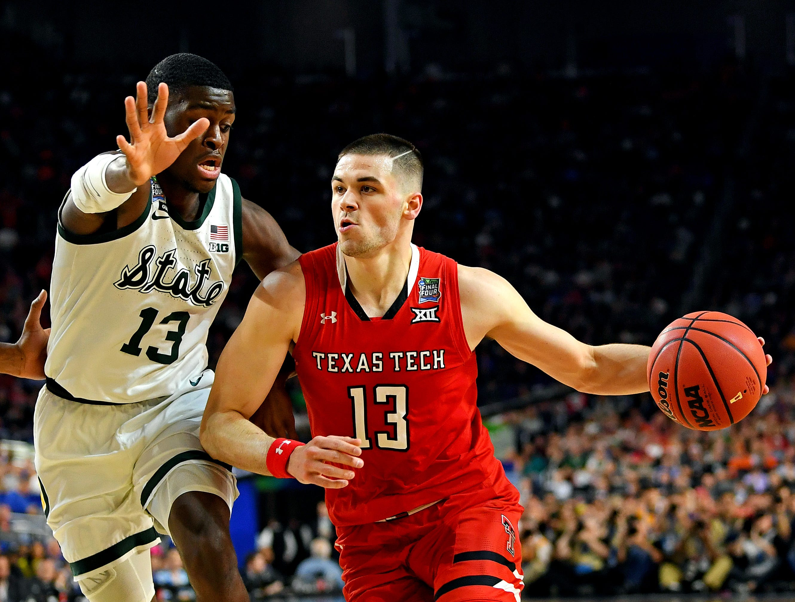 Apr 6, 2019; Minneapolis, MN, USA; Texas Tech Red Raiders guard Matt Mooney (13) drives to the basket against Michigan State Spartans forward Gabe Brown (13) during the second half in the semifinals of the 2019 men's Final Four at US Bank Stadium. Mandatory Credit: Bob Donnan-USA TODAY Sports