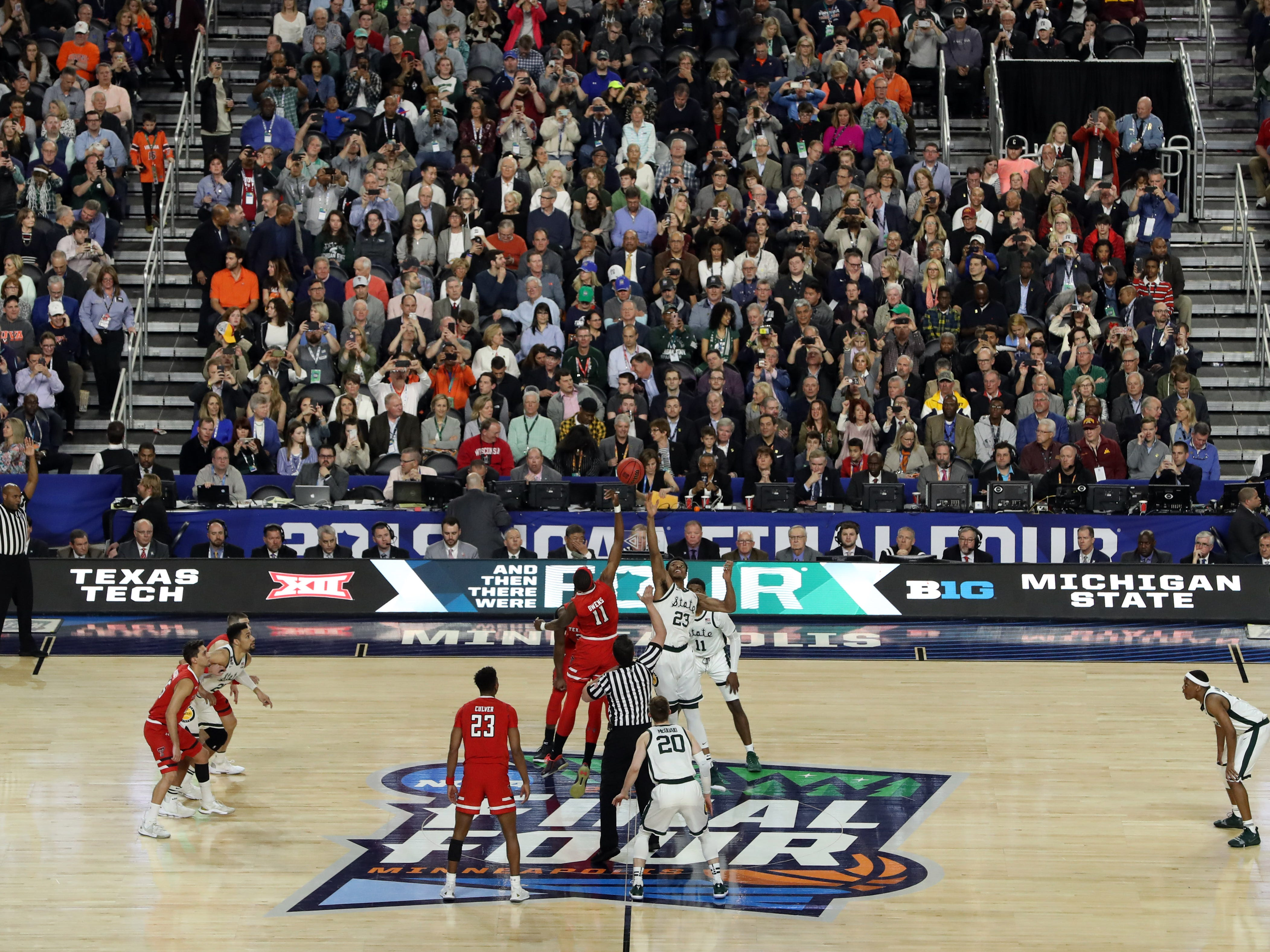 Apr 6, 2019; Minneapolis, MN, USA; The ball is tipped off in the semifinals of the 2019 men's Final Four game between the Michigan State Spartans and Texas Tech Red Raiders at US Bank Stadium. Mandatory Credit: Brace Hemmelgarn-USA TODAY Sports