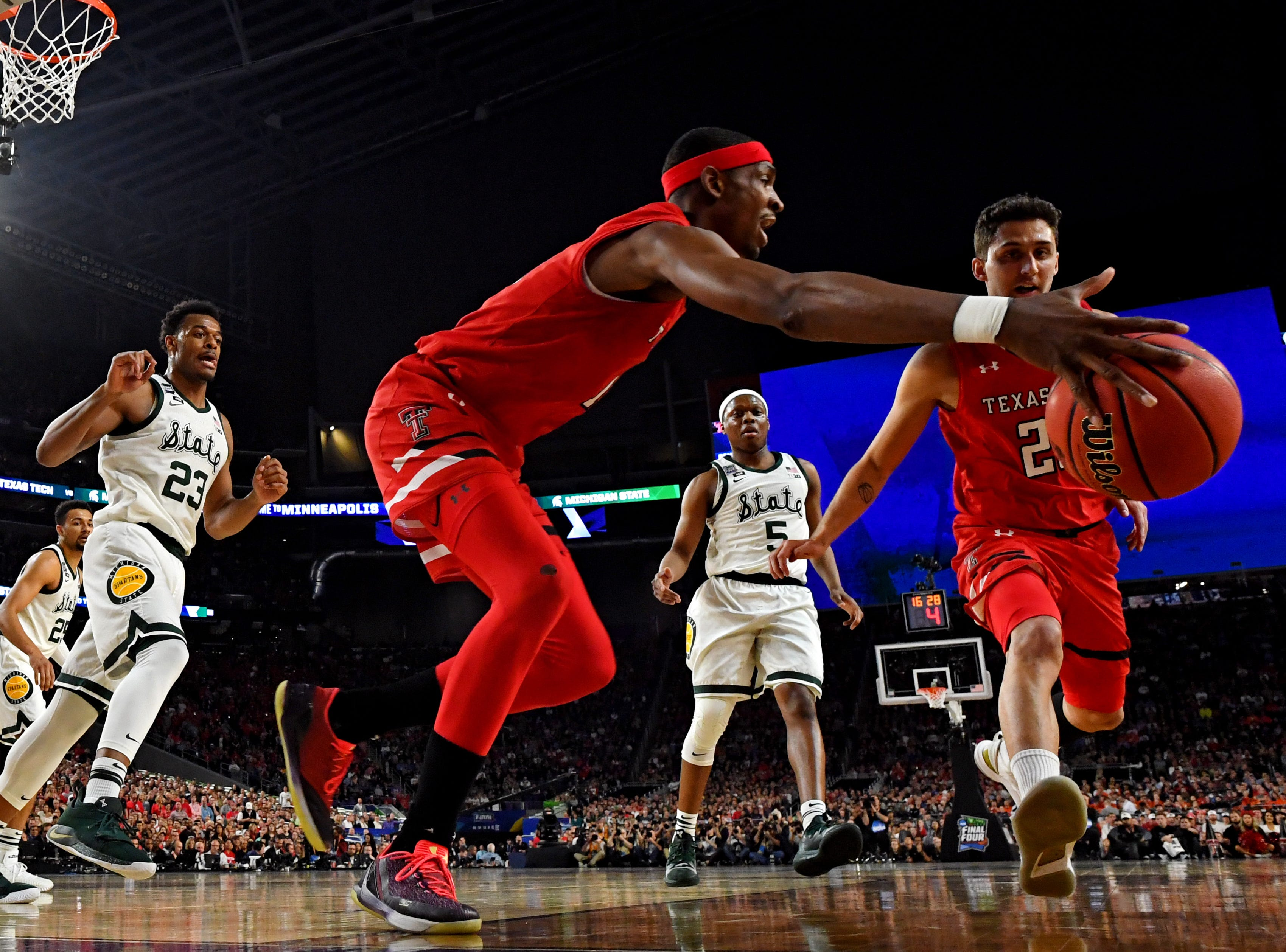 Apr 6, 2019; Minneapolis, MN, USA; Texas Tech Red Raiders forward Tariq Owens (11) and guard Davide Moretti (25) go for loose ball against Michigan State Spartans guard Cassius Winston (5) during the first half in the semifinals of the 2019 men's Final Four at US Bank Stadium. Mandatory Credit: Bob Donnan-USA TODAY Sports