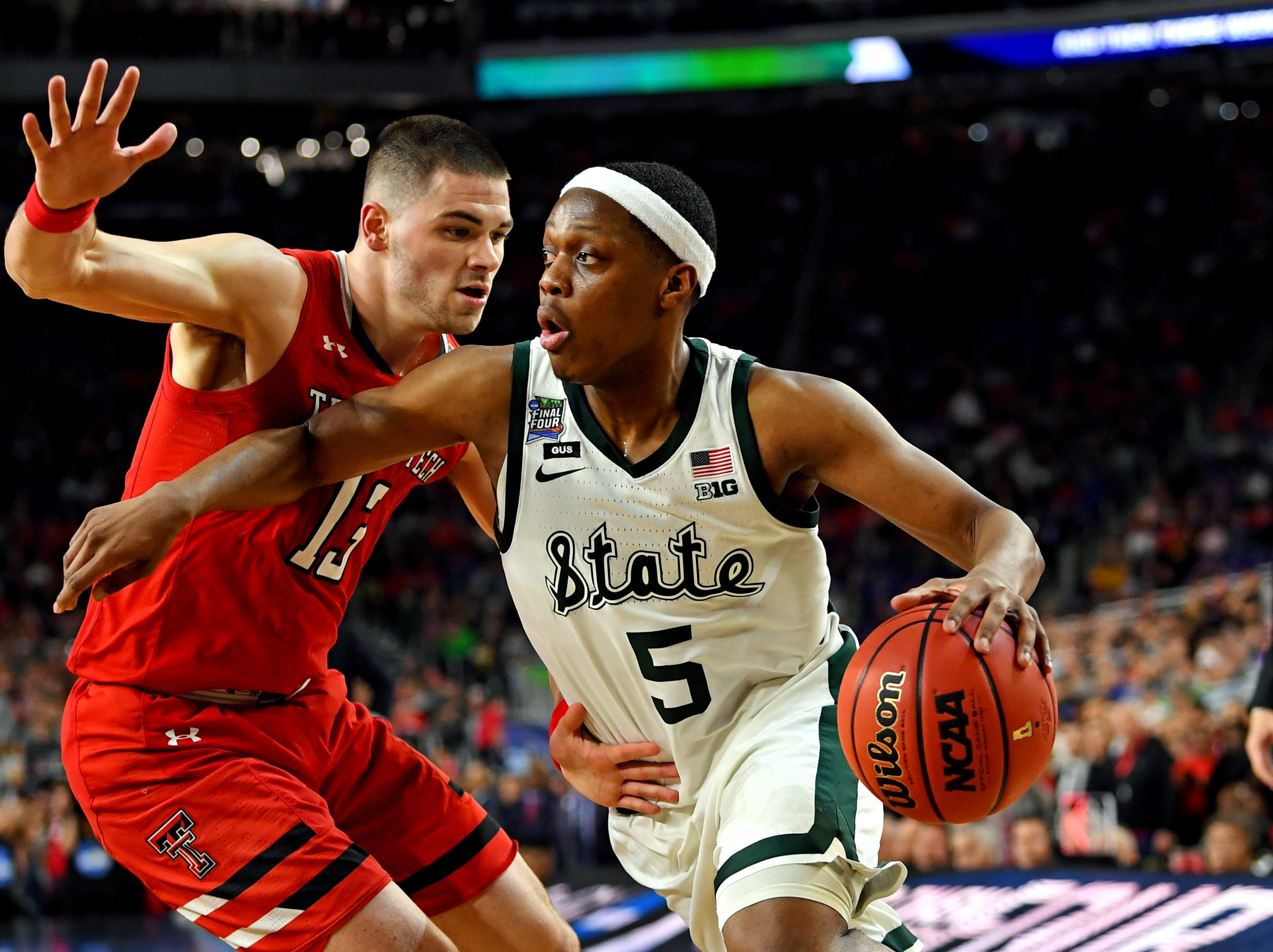 Apr 6, 2019; Minneapolis, MN, USA; Michigan State Spartans guard Cassius Winston (5) drives to the basket against Texas Tech Red Raiders guard Matt Mooney (13) during the second half in the semifinals of the 2019 men's Final Four at US Bank Stadium. Mandatory Credit: Bob Donnan-USA TODAY Sports
