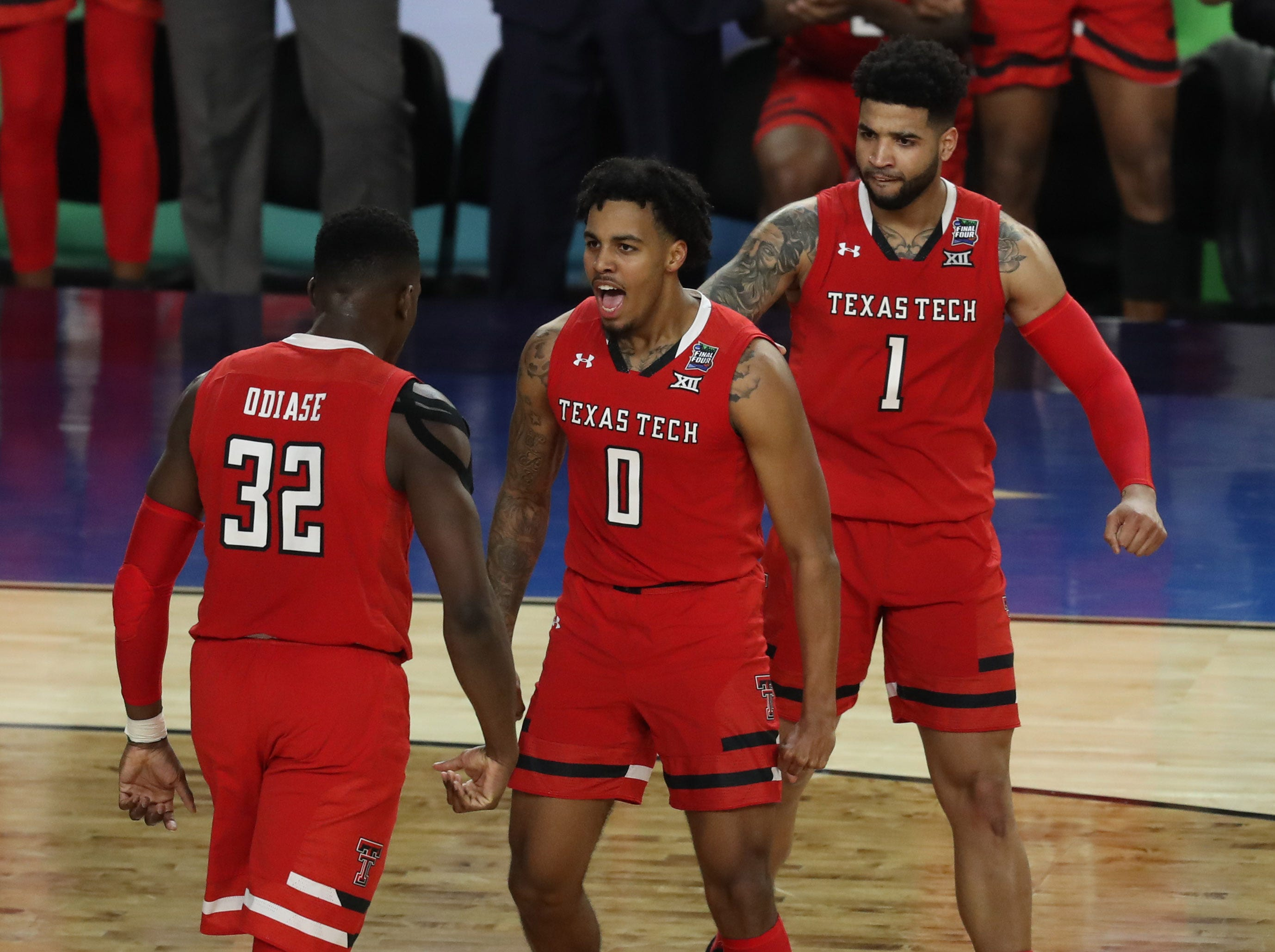 Apr 6, 2019; Minneapolis, MN, USA; Texas Tech Red Raiders guard Kyler Edwards (0) celebrates with Texas Tech Red Raiders center Norense Odiase (32) after drawing a foul during the second half against the Michigan State Spartans in the semifinals of the 2019 men's Final Four at US Bank Stadium. Mandatory Credit: Brace Hemmelgarn-USA TODAY Sports