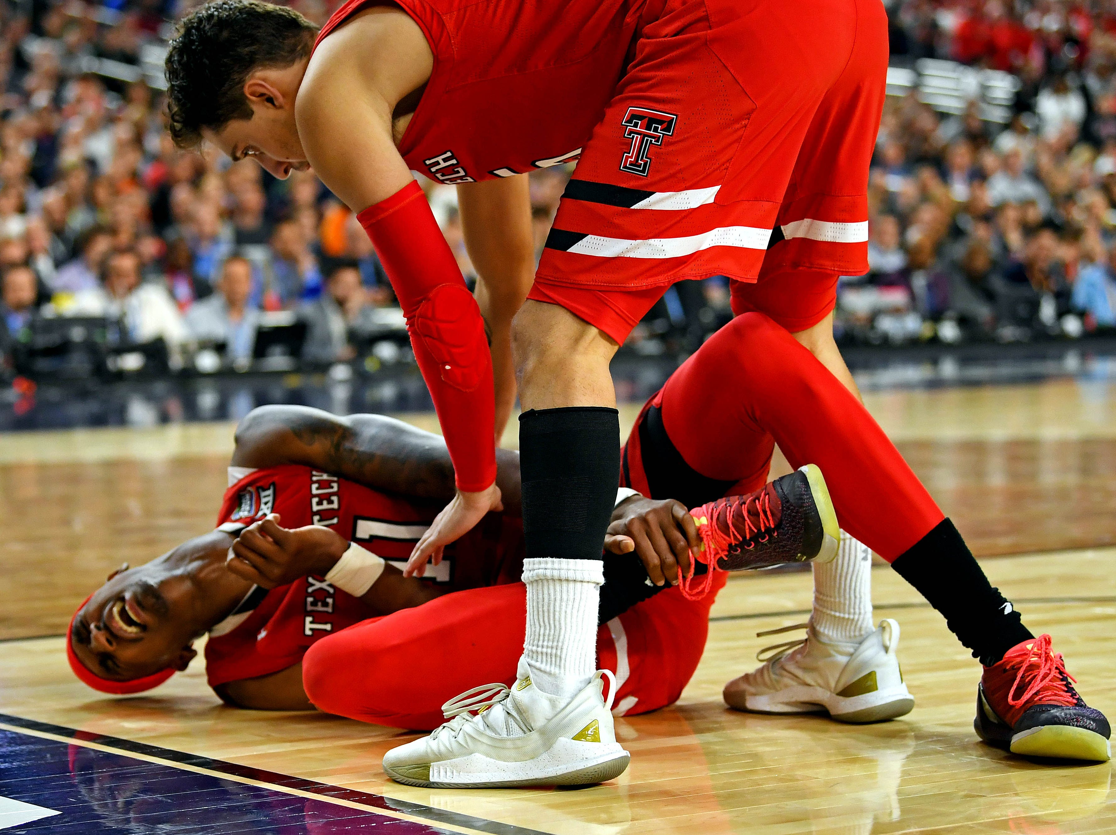Apr 6, 2019; Minneapolis, MN, USA; Texas Tech Red Raiders forward Tariq Owens (11) reacts after an injury during the second half against the Michigan State Spartans in the semifinals of the 2019 men's Final Four at US Bank Stadium. Mandatory Credit: Bob Donnan-USA TODAY Sports