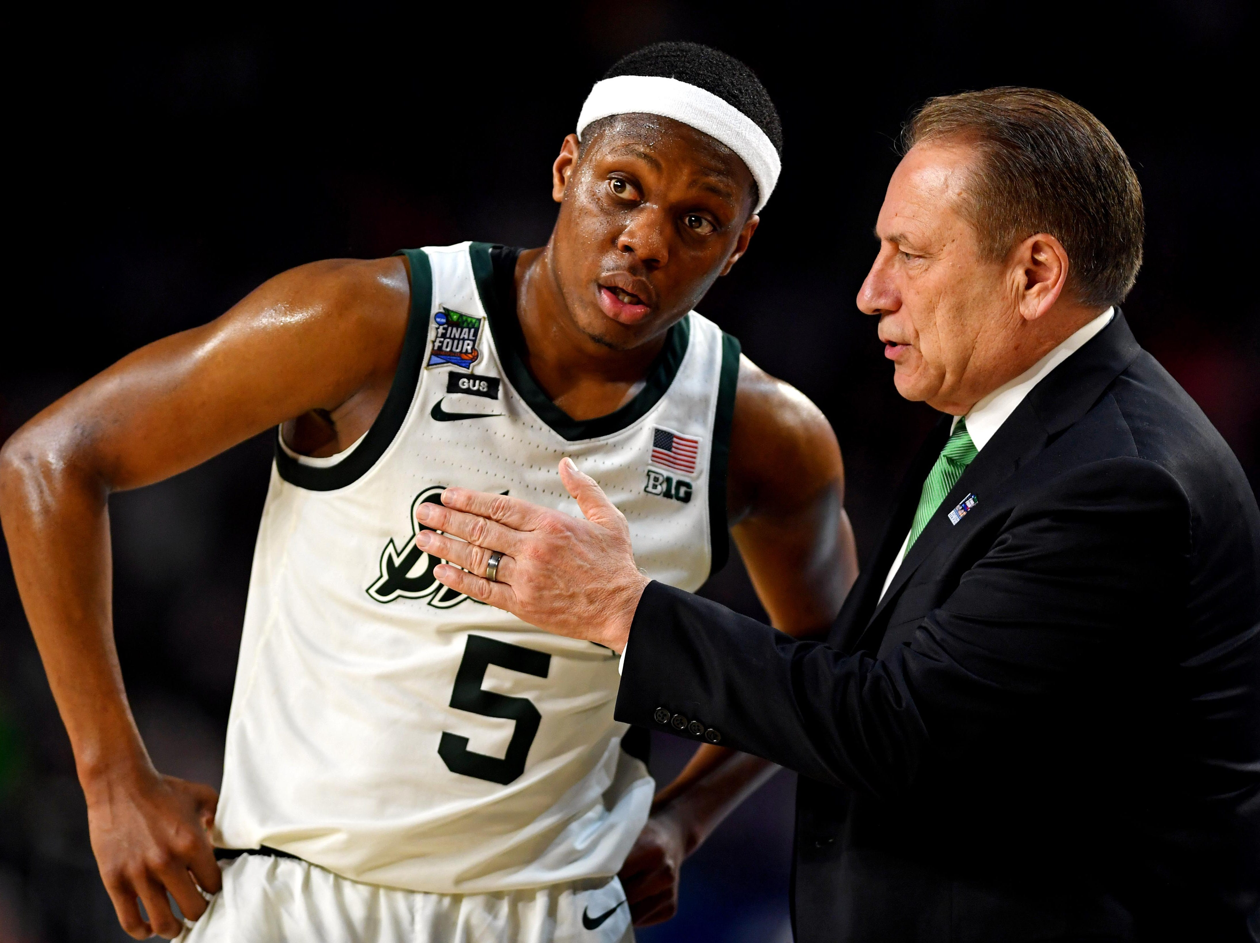 Apr 6, 2019; Minneapolis, MN, USA; Michigan State Spartans guard Cassius Winston (5) talks to Michigan State Spartans head coach Tom Izzo during the second half against the Texas Tech Red Raiders in the semifinals of the 2019 men's Final Four at US Bank Stadium. Mandatory Credit: Bob Donnan-USA TODAY Sports