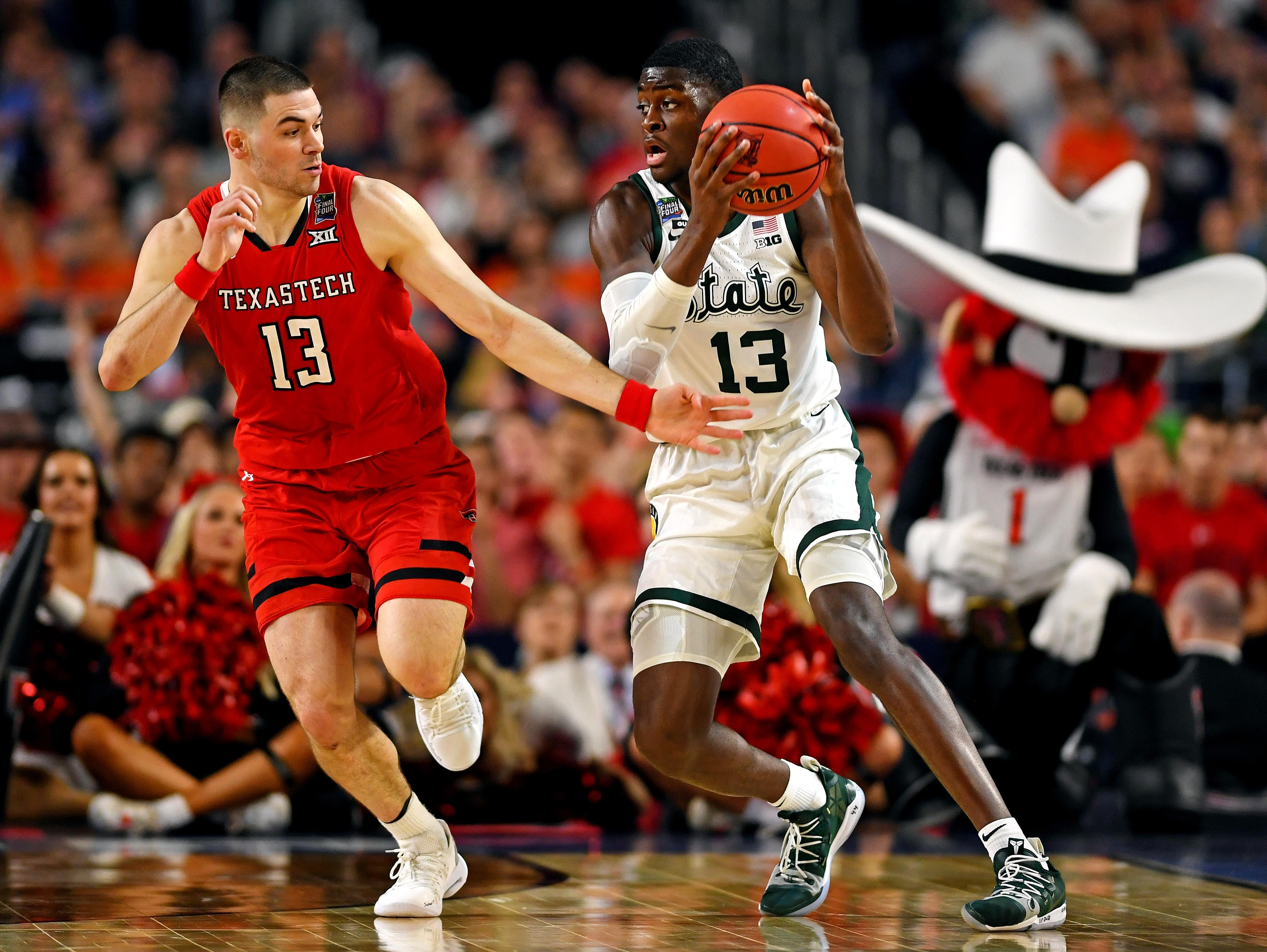 Apr 6, 2019; Minneapolis, MN, USA; Michigan State Spartans forward Gabe Brown (13) handles the ball against Texas Tech Red Raiders guard Matt Mooney (13) during the first half in the semifinals of the 2019 men's Final Four at US Bank Stadium. Mandatory Credit: Bob Donnan-USA TODAY Sports