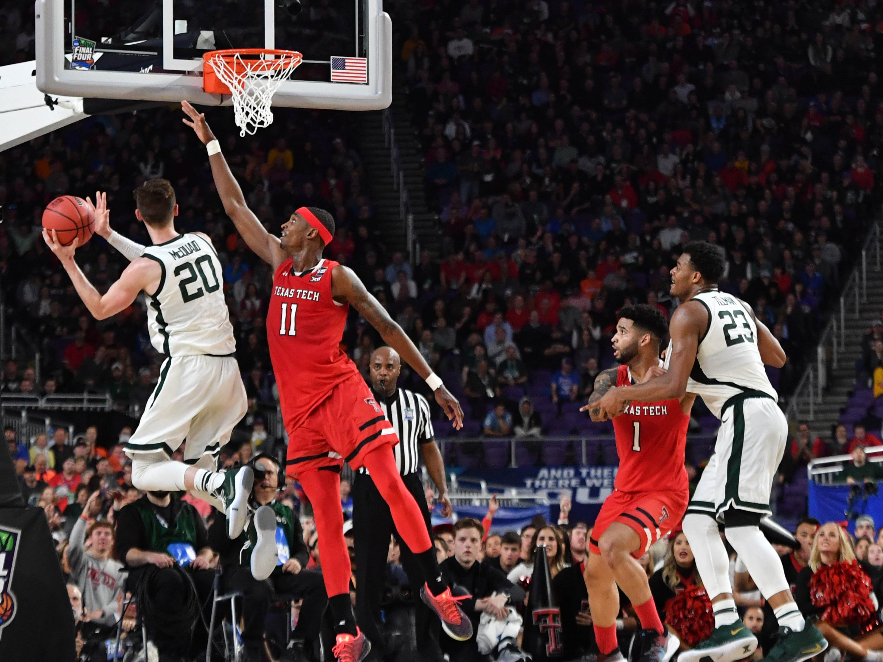 Apr 6, 2019; Minneapolis, MN, USA; Michigan State Spartans guard Matt McQuaid (20) shoots against Texas Tech Red Raiders forward Tariq Owens (11) in the semifinals of the 2019 men's Final Four at US Bank Stadium. Mandatory Credit: Robert Deutsch-USA TODAY Sports