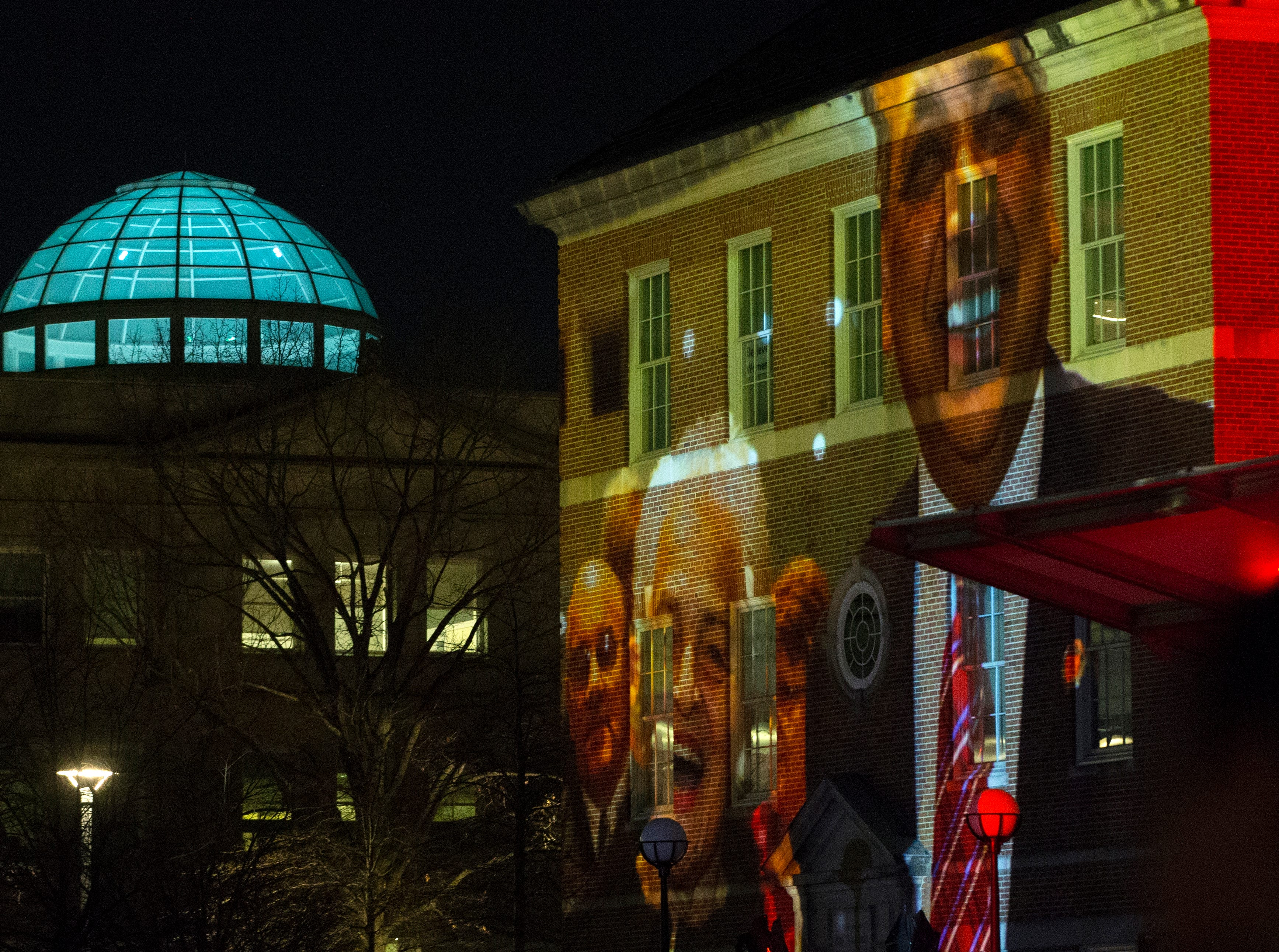 University of Cincinnati president Neville G. Pinto and Marian Spencer images displayed on McMicken Hall with Van Wormer Hall gleaming blue dome during Community Day to celebrate UC's Bicentennial Saturday April 6, 2019 at McMicken Commons on the campus of the University of Cincinnati. University of Cincinnati/Joseph Fuqua II