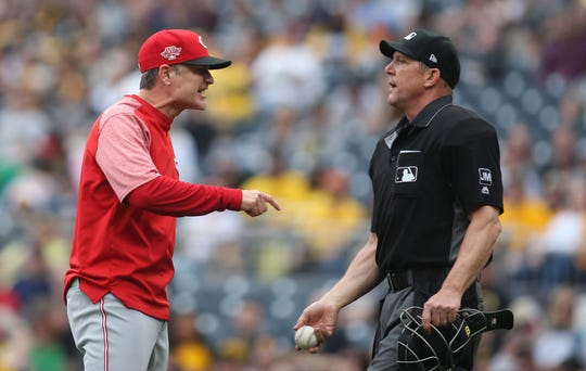 Apr 7, 2019; Pittsburgh, PA, USA; Cincinnati Reds manager David Bell (25) argues with home plate umpire Jeff Kellogg (R) against the Pittsburgh Pirates during the fourth inning at PNC Park. Mandatory Credit: Charles LeClaire-USA TODAY Sports