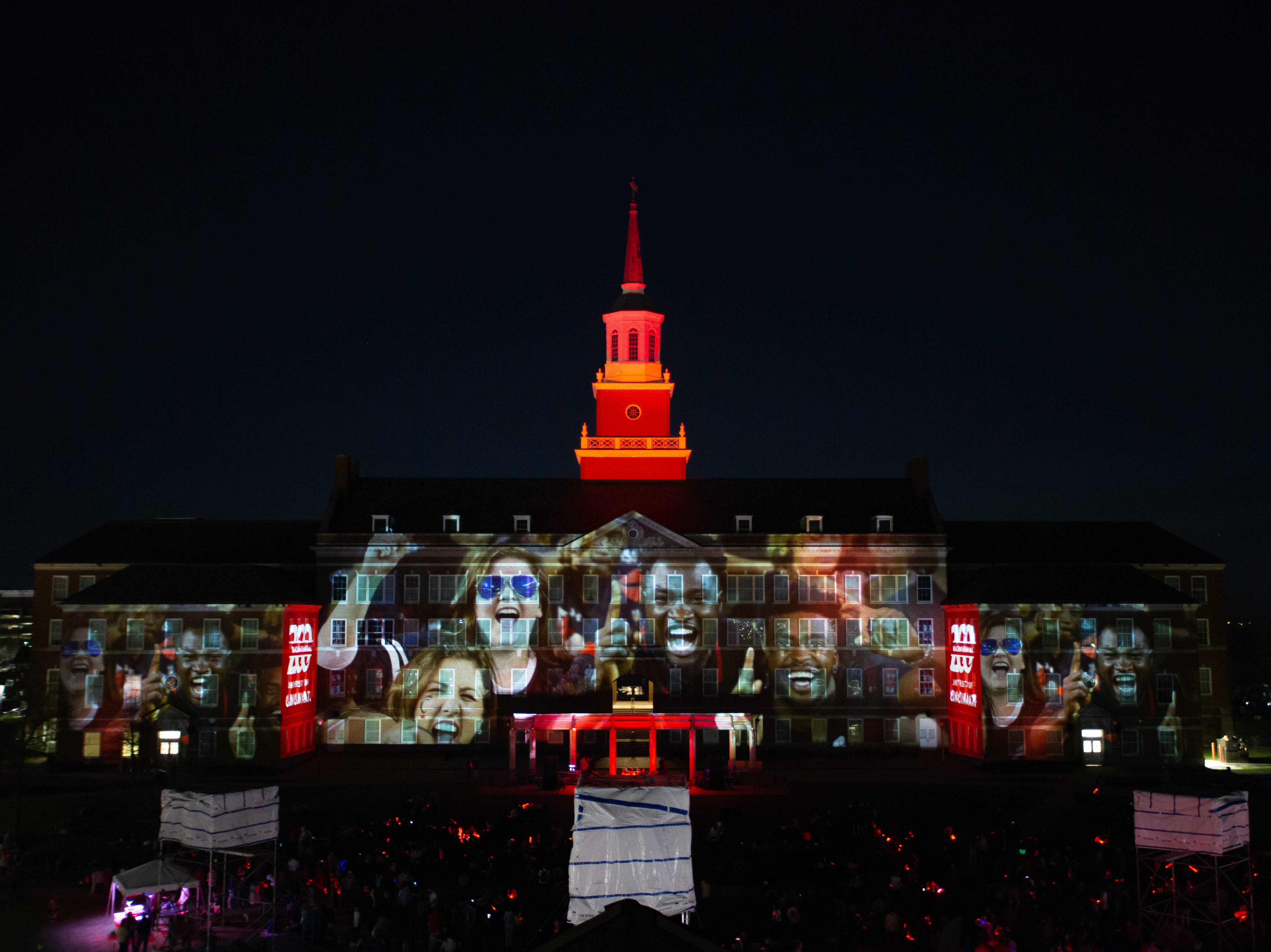 University of Cincinnati screaming Football Fans images adorned McMicken Hall during Community Day to celebrate UC's Bicentennial Saturday April 6, 2019 at McMicken Commons on the campus of the University of Cincinnati. Photo by Andrew Higley/University of Cincinnati