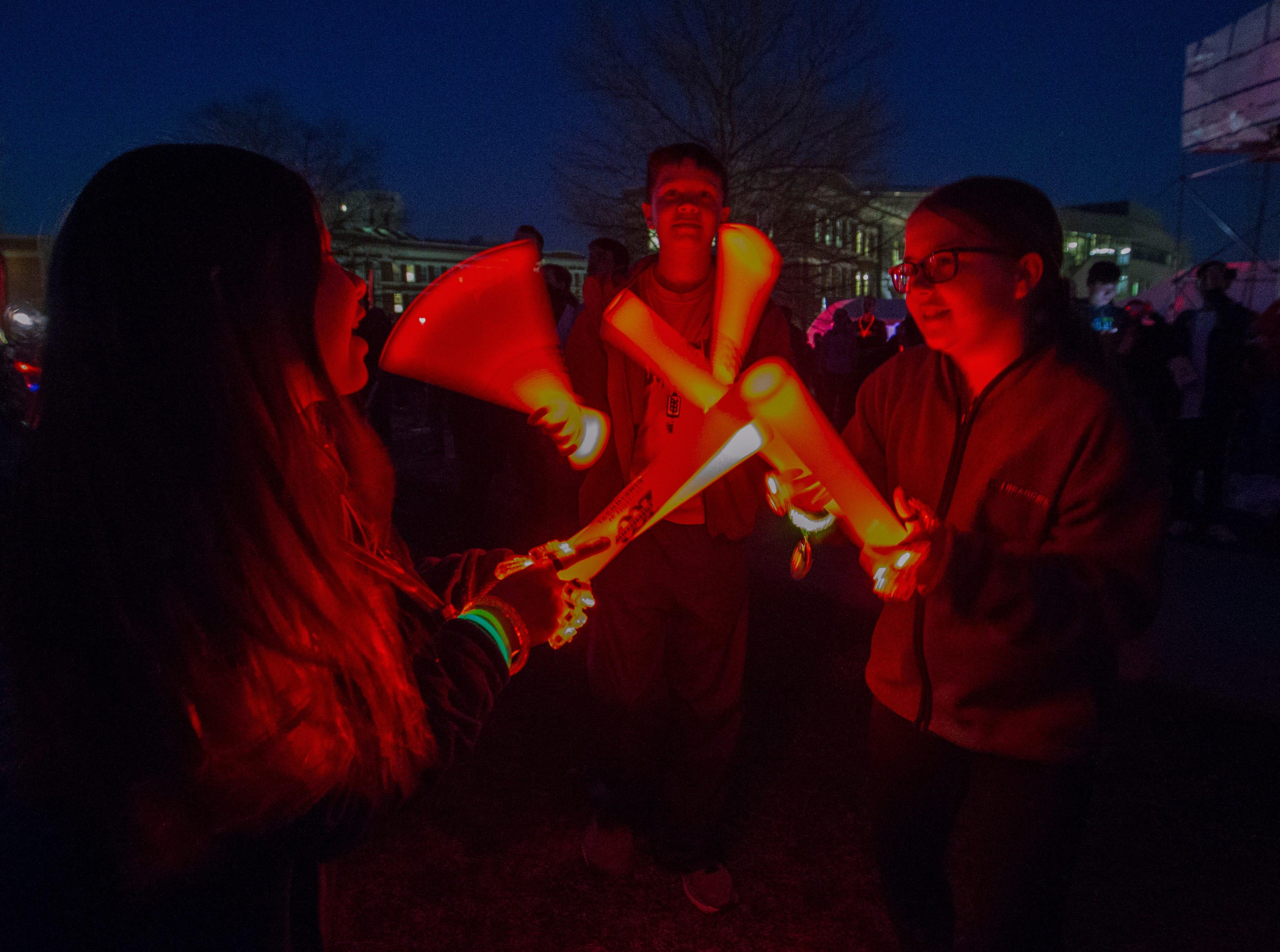 Kids played with their glow sticks during Momentum Projection-Mapping Light Show Saturday April 6, 2019. University of Cincinnati/Joseph Fuqua II