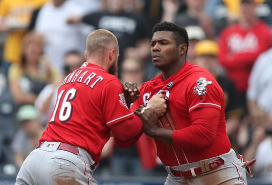 Apr 7, 2019; Pittsburgh, PA, USA; Cincinnati Reds catcher Tucker Barnhart (16) attempts to restrain right fielder Yasiel Puig (66) during a benches clearing altercation against the Pittsburgh Pirates during the fourth inning at PNC Park. Mandatory Credit: Charles LeClaire-USA TODAY Sports
