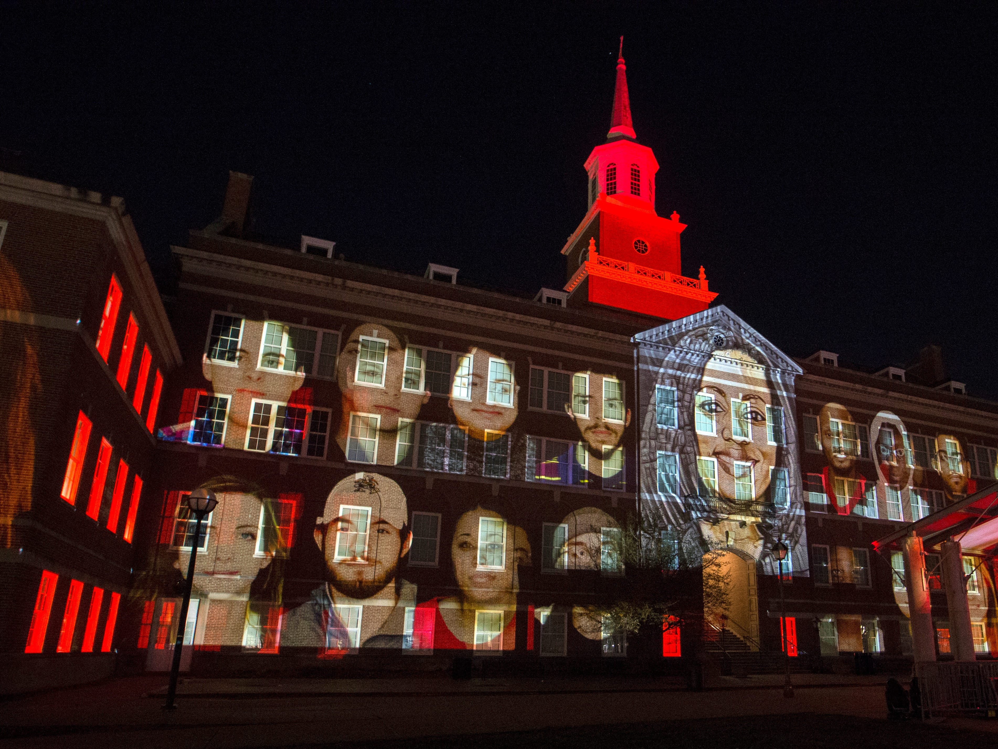 University of Cincinnati Faculties and Students images displayed on McMicken Hall during Community Day to celebrate UC's Bicentennial Saturday April 6, 2019 at McMicken Commons on the campus of the University of Cincinnati. University of Cincinnati/Joseph Fuqua II