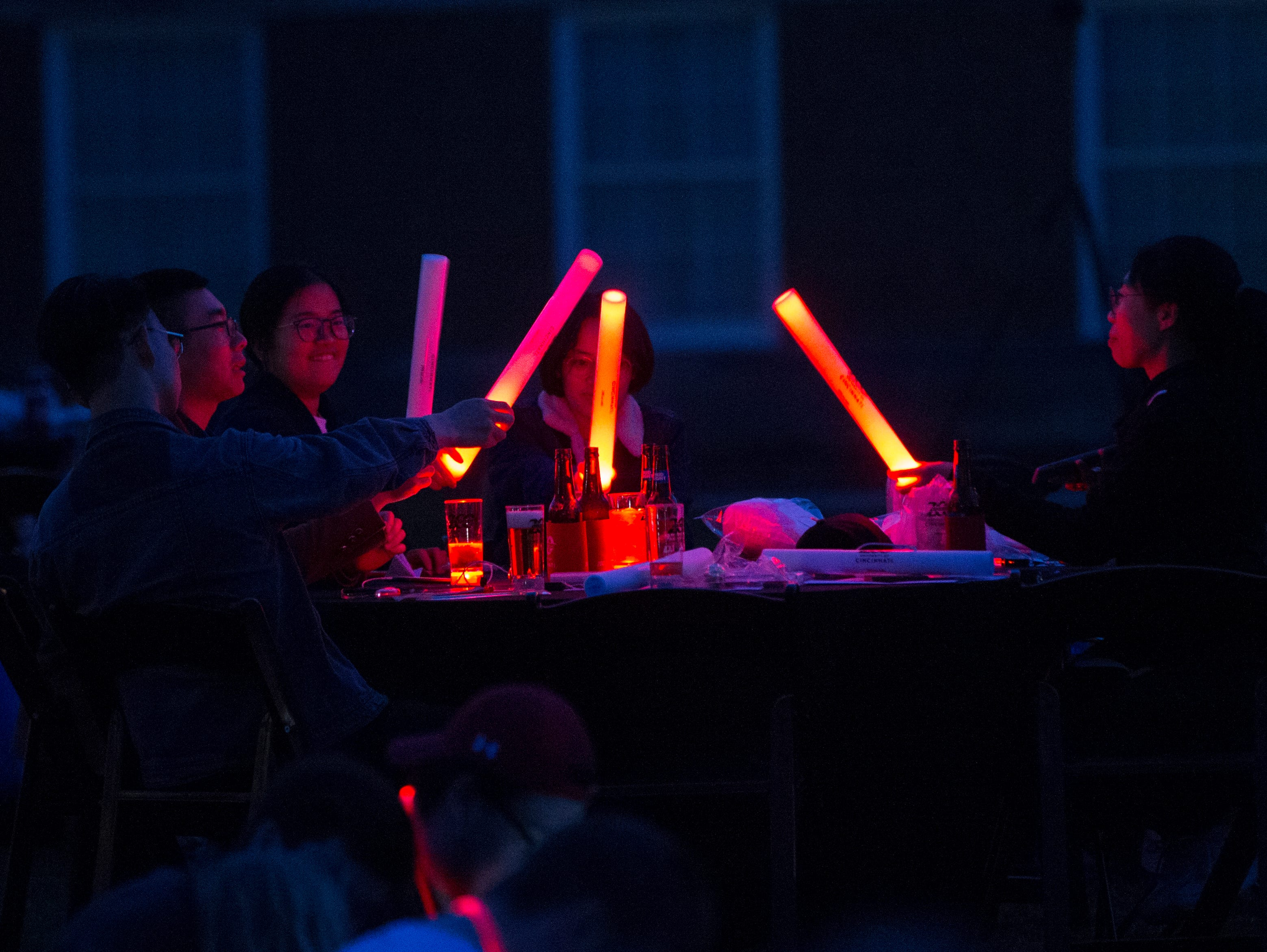 UC students played with their glow sticks during Momentum Projection-Mapping Light Show Saturday April 6, 2019. University of Cincinnati/Joseph Fuqua II