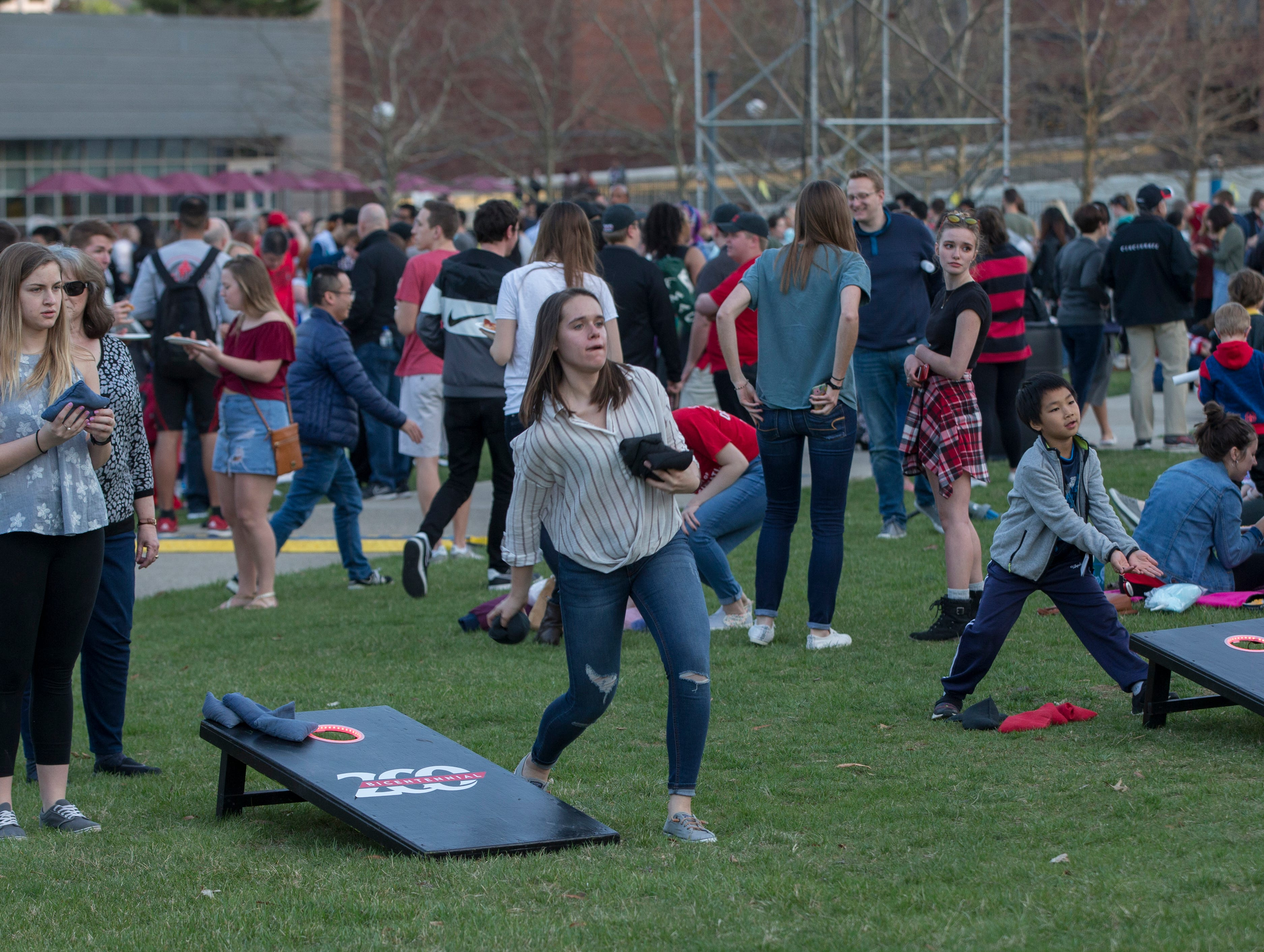 UC students and families played corn hole out on McMicken Commons during Community Day to celebrate UC's Bicentennial Saturday April 6, 2019. University of Cincinnati/Joseph Fuqua II