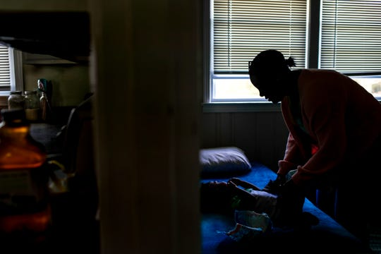 Shanesse Webber, right, changes the diaper on her youngest son Ezra, 2, left, at the Webber household in Clarksville, Tenn., on Saturday, April 6, 2019.