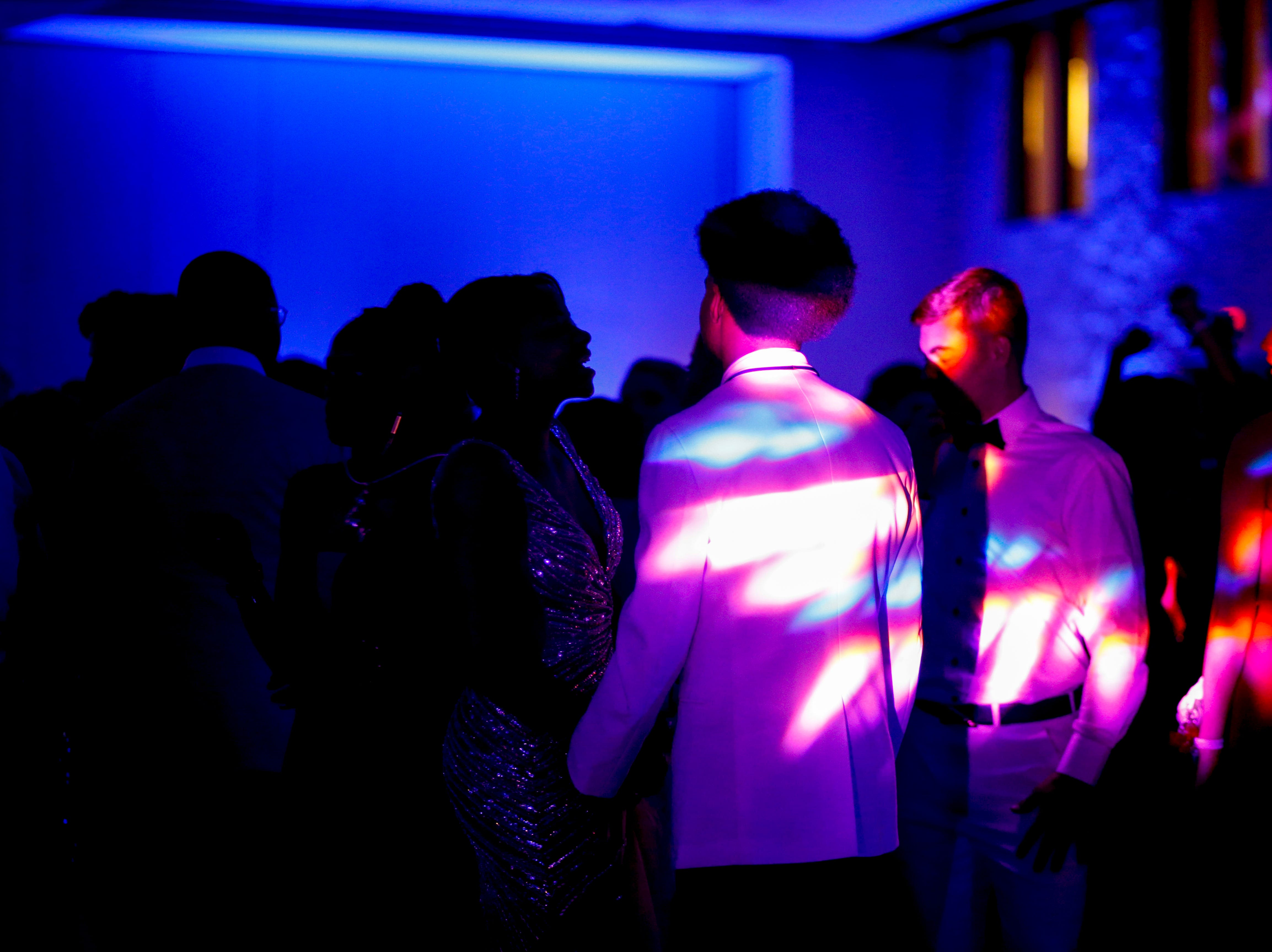 Light emitted from machines lights up students on the dance floor during Clarksville Academy's 2019 prom at The Bruce Convention Center in Hopkinsville, Ky., on Saturday, April 6, 2019.