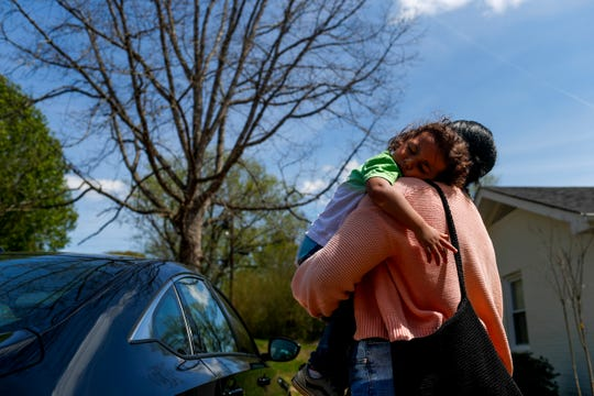 Ezra Webber, 2, holds onto his mother Shanesse Weber after falling asleep in the car on the way home from lunch at the Webber household in Clarksville, Tenn., on Saturday, April 6, 2019.