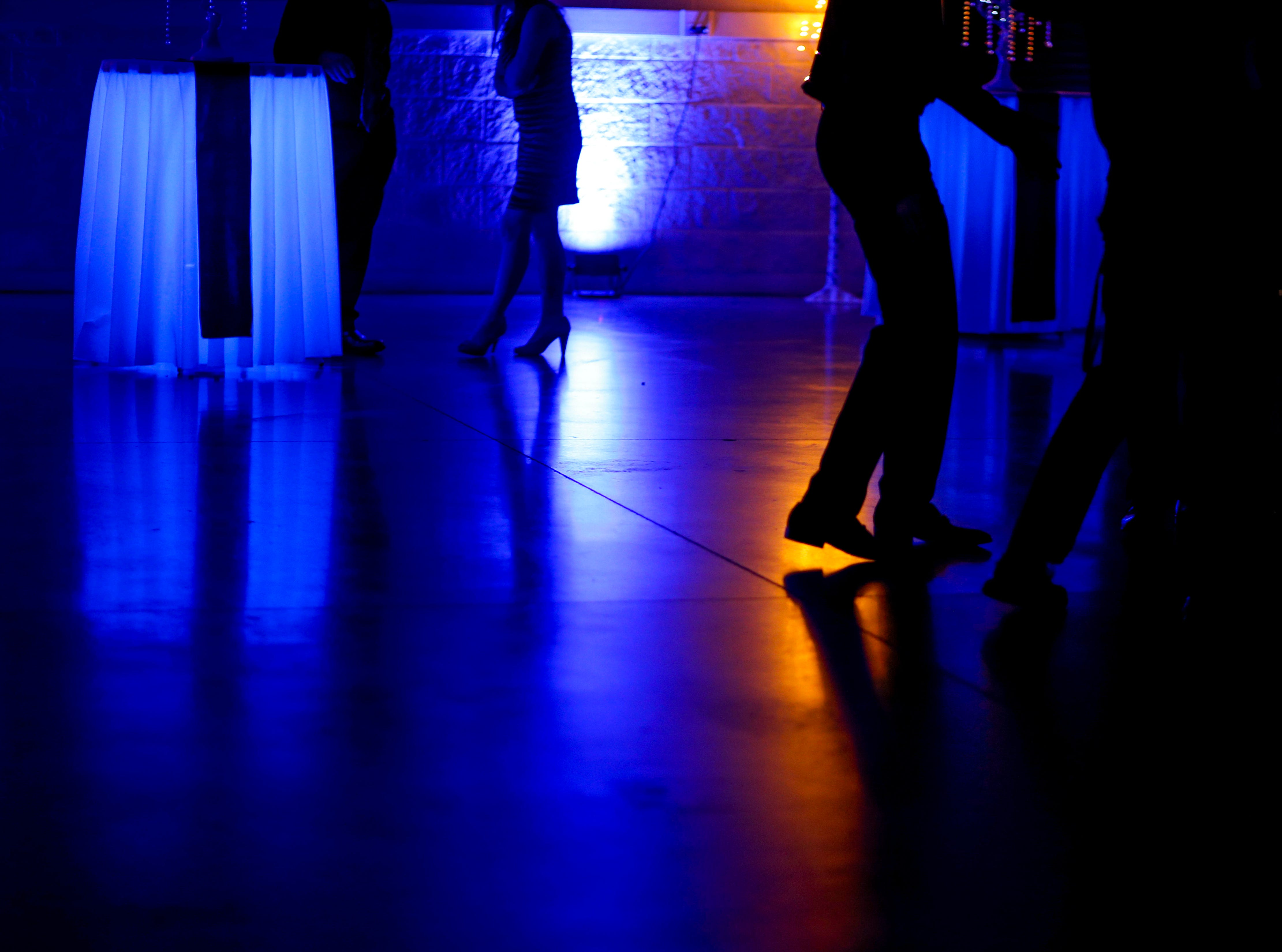 Students slowly trickle onto the dance floor during Clarksville Academy's 2019 prom at The Bruce Convention Center in Hopkinsville, Ky., on Saturday, April 6, 2019.