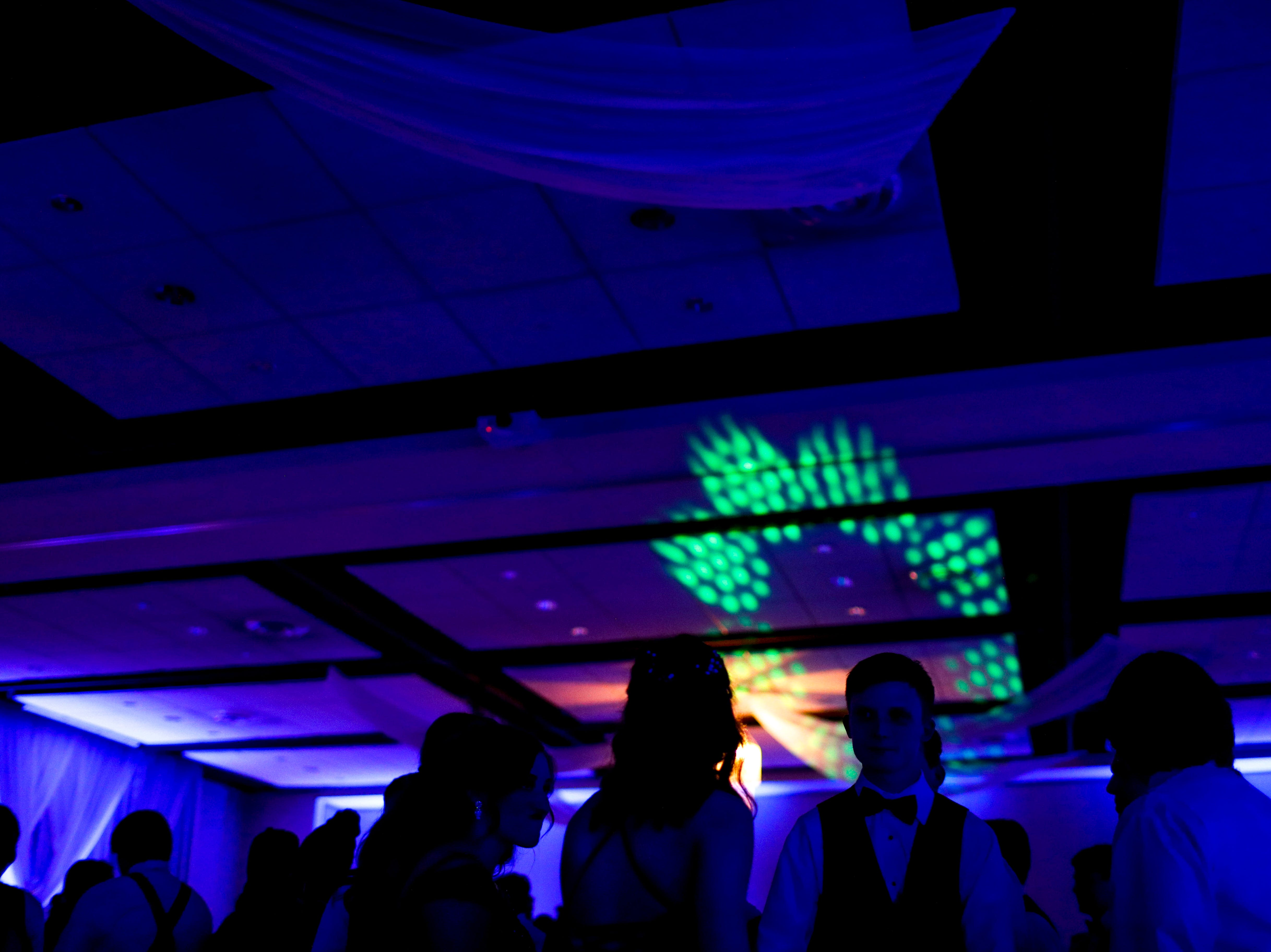 Students dance in small groups during Clarksville Academy's 2019 prom at The Bruce Convention Center in Hopkinsville, Ky., on Saturday, April 6, 2019.