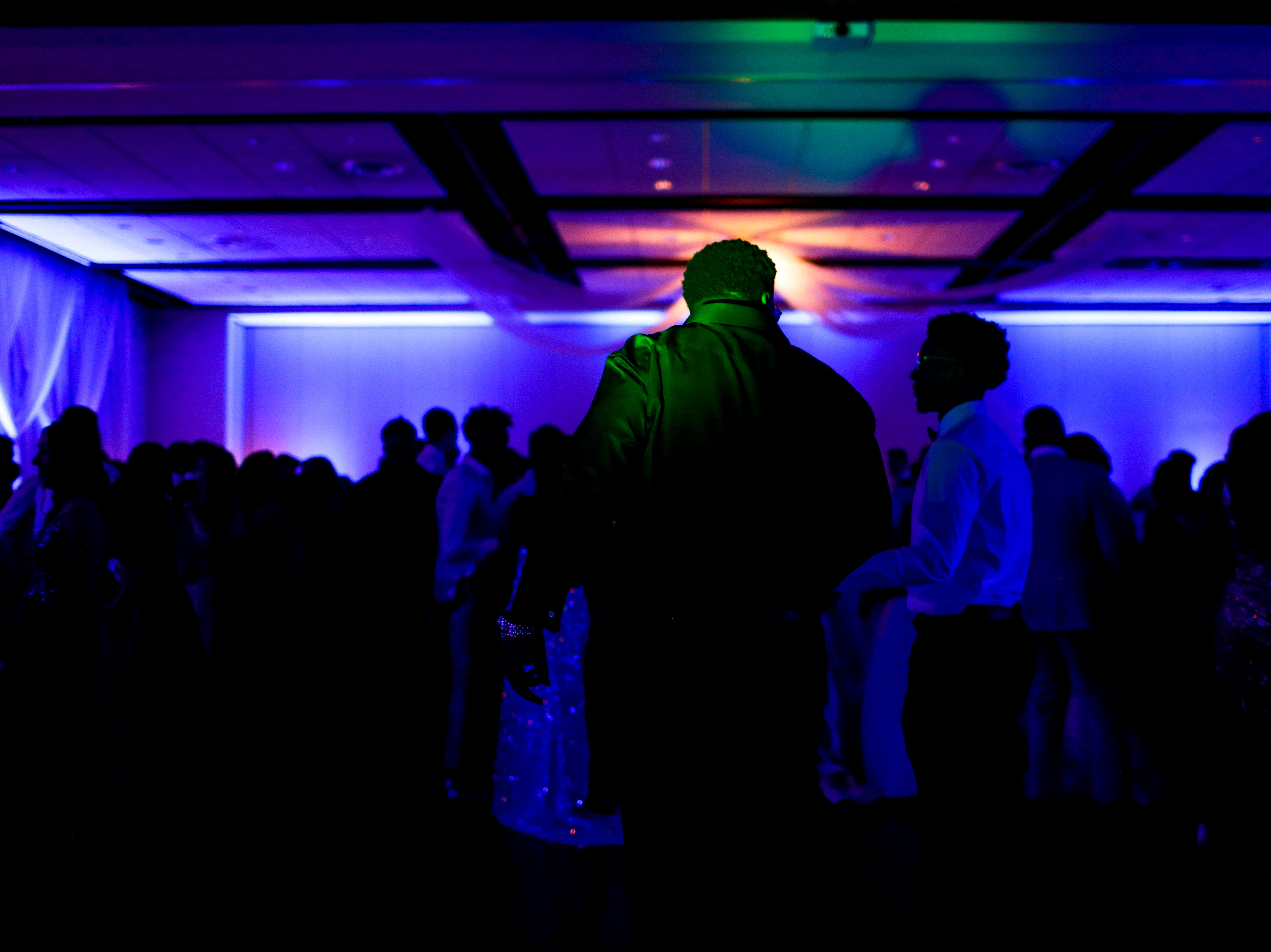 Students enter the dance floor during Clarksville Academy's 2019 prom at The Bruce Convention Center in Hopkinsville, Ky., on Saturday, April 6, 2019.