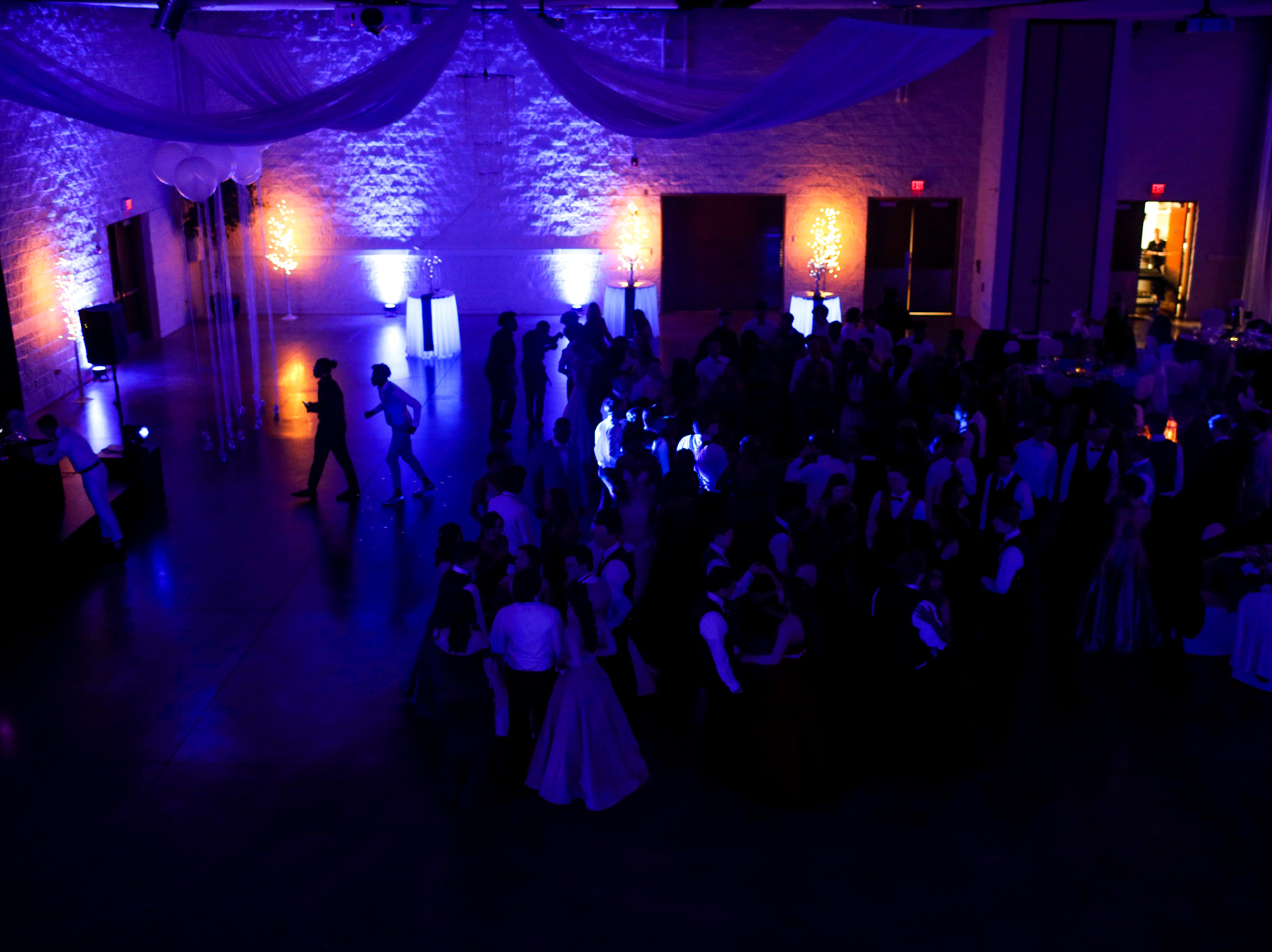 Students gather together in the center of the dance floor to dance during Clarksville Academy's 2019 prom at The Bruce Convention Center in Hopkinsville, Ky., on Saturday, April 6, 2019.