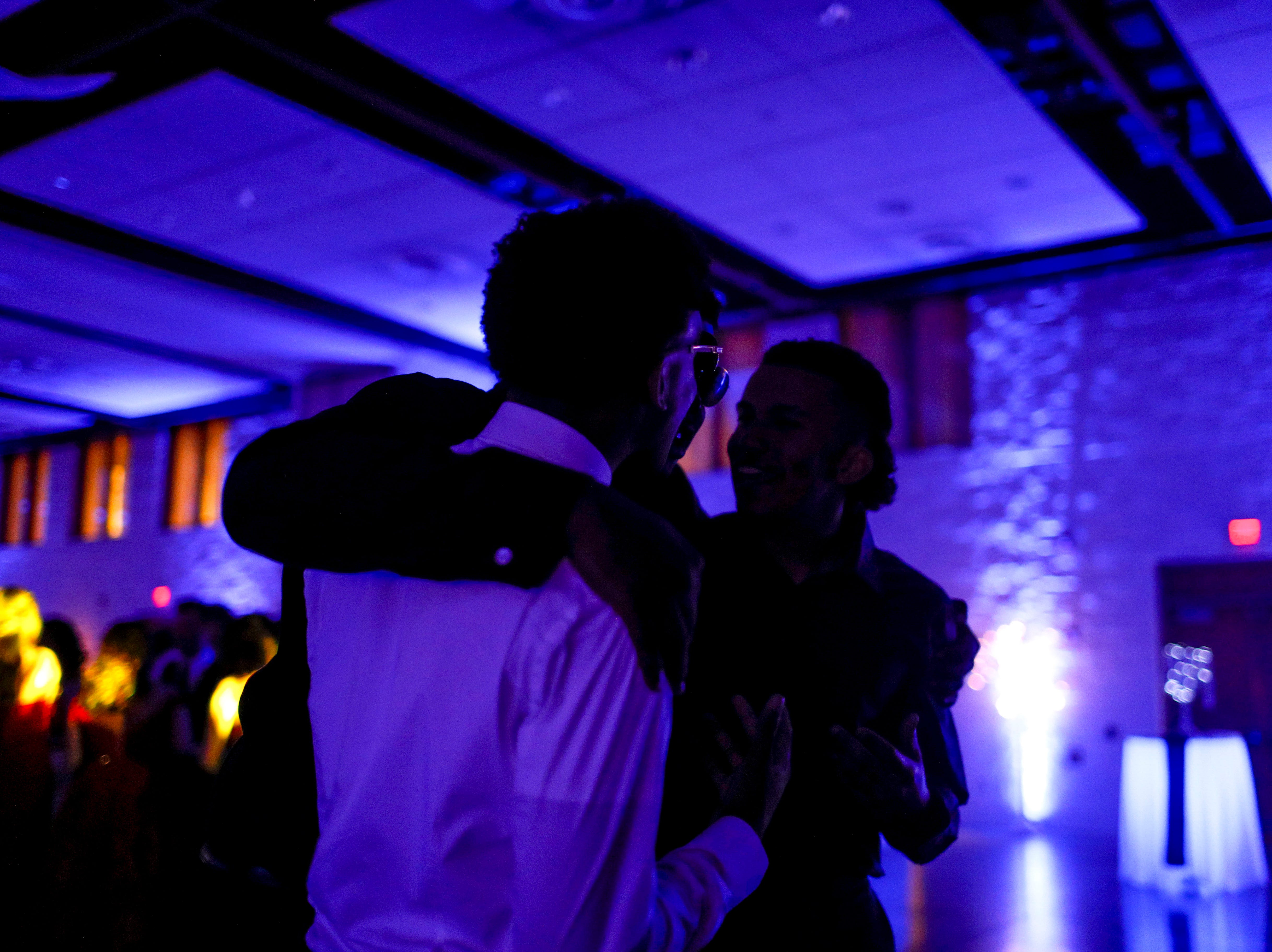 Students approach the DJ platform prepared to write down song requests during Clarksville Academy's 2019 prom at The Bruce Convention Center in Hopkinsville, Ky., on Saturday, April 6, 2019.
