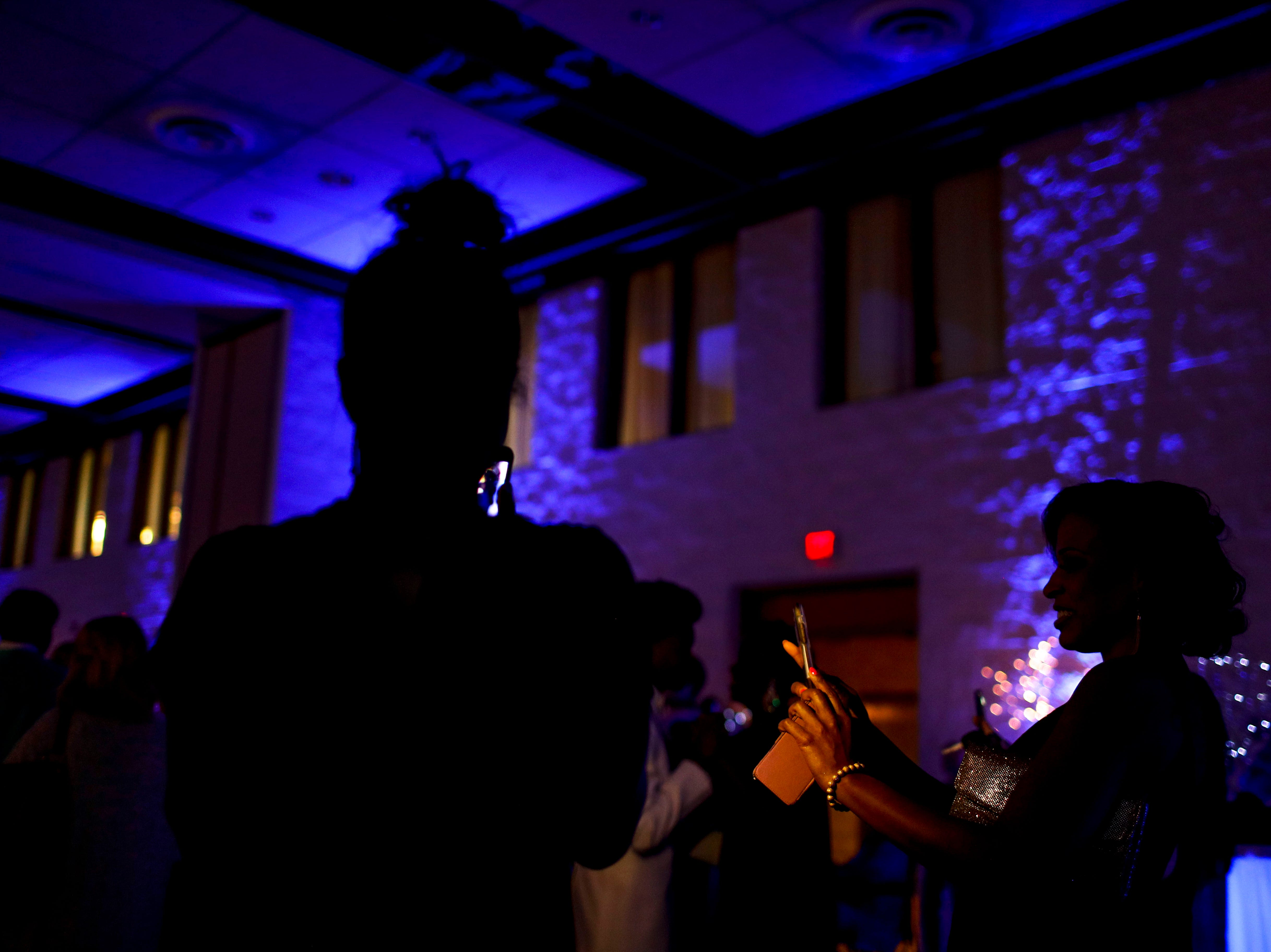 A parent snaps a photo of her kid before the mother-son dance during Clarksville Academy's 2019 prom at The Bruce Convention Center in Hopkinsville, Ky., on Saturday, April 6, 2019.