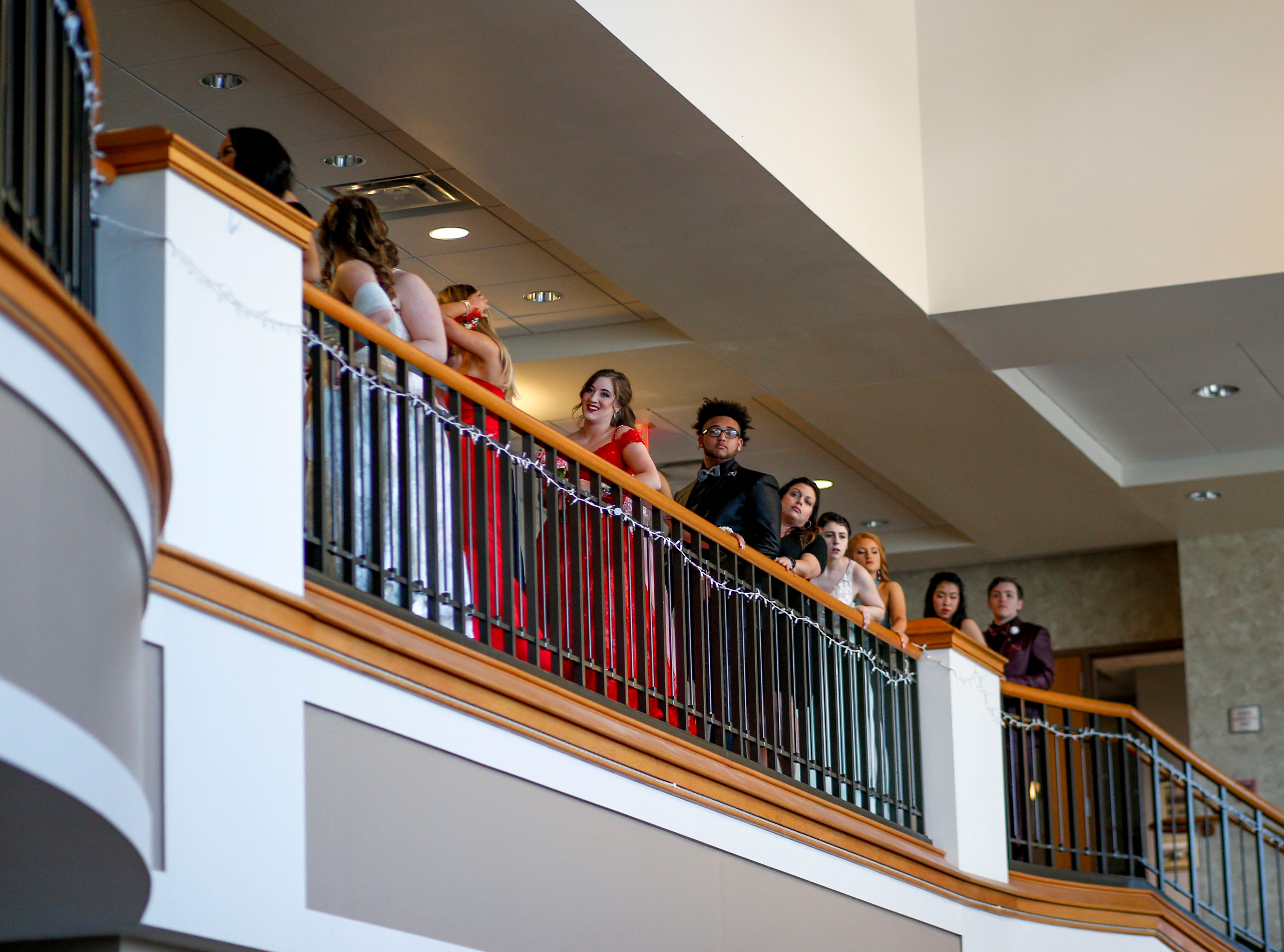 Students form a line before descending a staircase to walk in front of friends and family during Clarksville Academy's 2019 prom at The Bruce Convention Center in Hopkinsville, Ky., on Saturday, April 6, 2019.