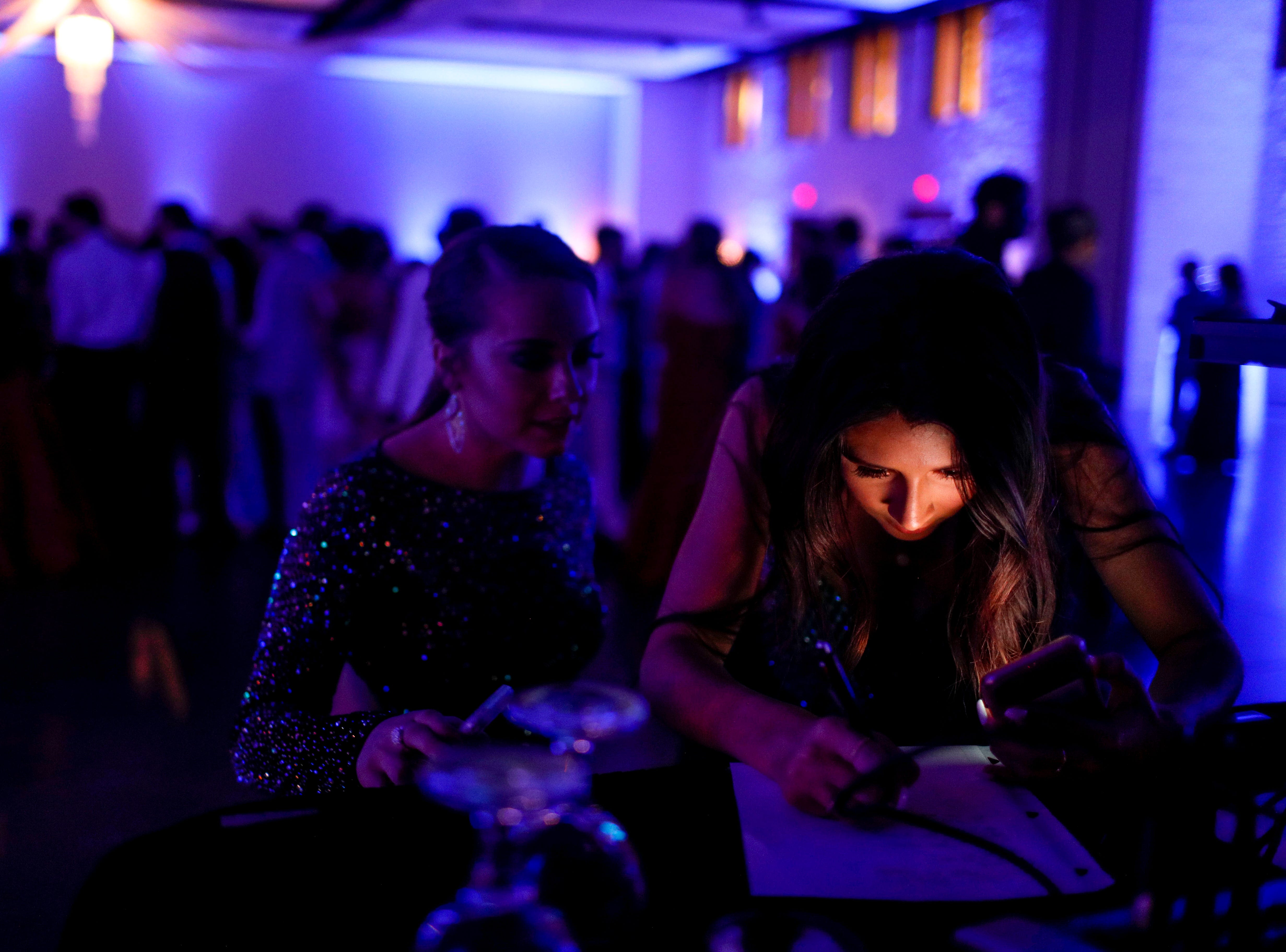 Students approach the DJ to write down song requests during Clarksville Academy's 2019 prom at The Bruce Convention Center in Hopkinsville, Ky., on Saturday, April 6, 2019.