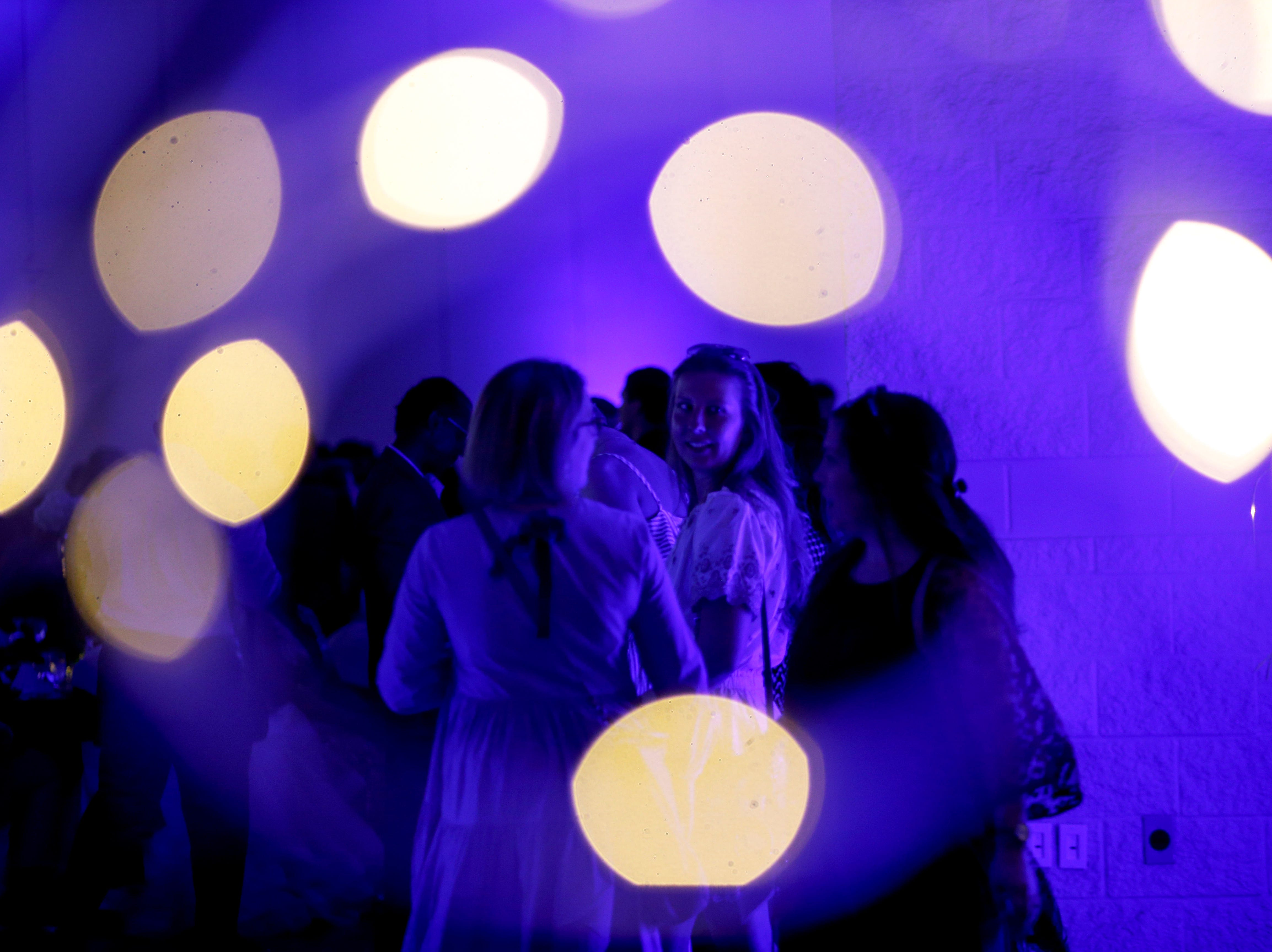 Students gather to the side of the room before the annual father-daughter dance during Clarksville Academy's 2019 prom at The Bruce Convention Center in Hopkinsville, Ky., on Saturday, April 6, 2019.