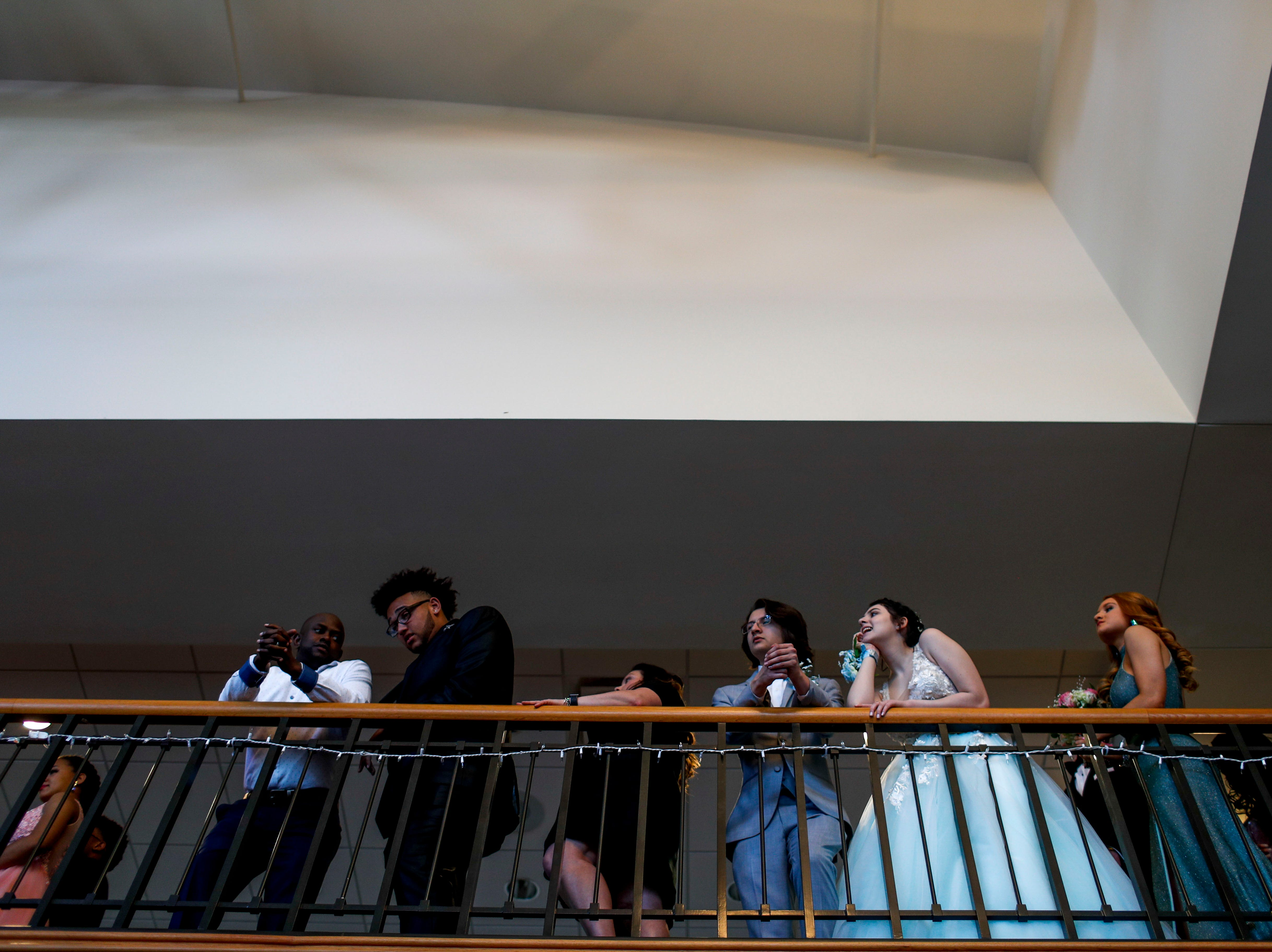 Juniors and seniors line the balcony of the second floor before taking a walk down a flight of stairs before friends and relatives during Clarksville Academy's 2019 prom at The Bruce Convention Center in Hopkinsville, Ky., on Saturday, April 6, 2019.
