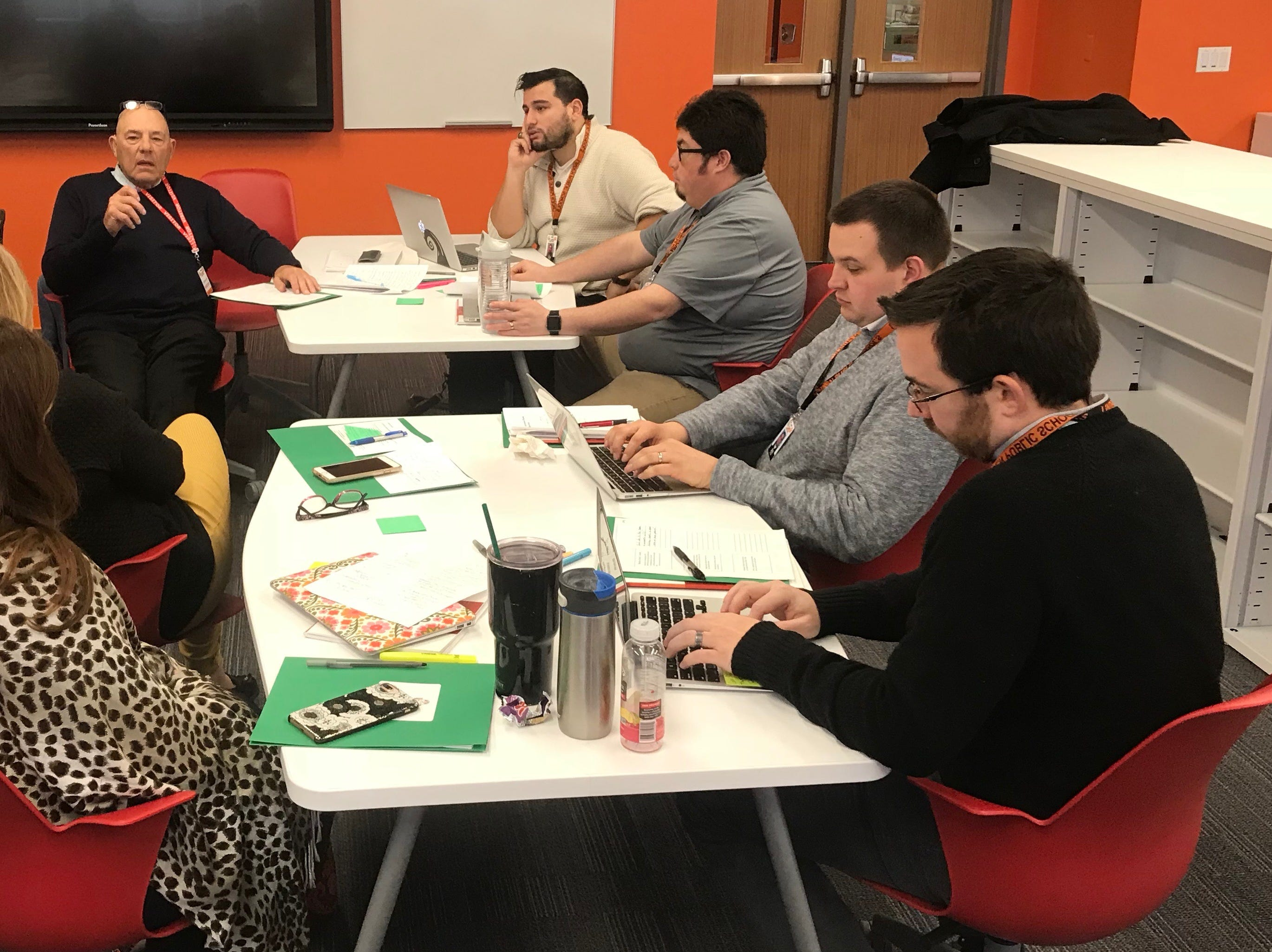 Harvey Silver, back left, of The Thoughtful Classroom leads a discussion with Linden High School teachers to go over a lesson delivered by teachers Jorge Alvarez and Anthony Fischetti, back right, in the LHS Learning Commons.