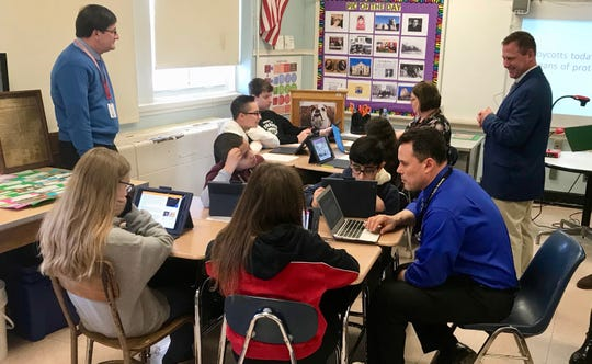 McManus Middle School teachers Anthony Ventura and Jennifer Pivano deliver a lesson to small groups of students about the effectiveness of boycotts, as Principal Peter Fingerlin, right, and Tom Dewing of The Thoughtful Classroom observe.
