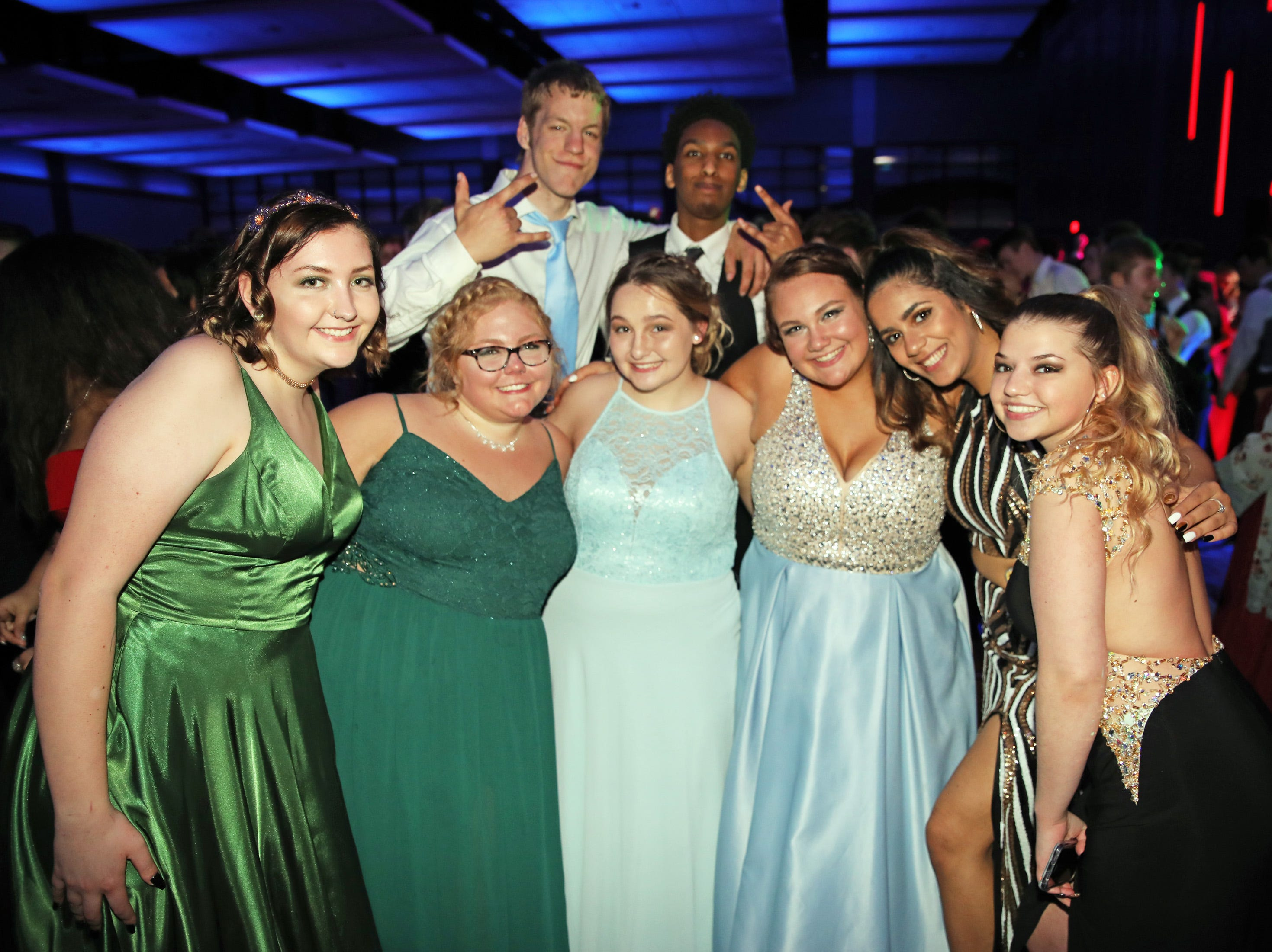 Warrior students stop for a group photo during the Waukee High School Prom at the Ron Pearson Center in West Des Moines on Saturday, April 6, 2019.