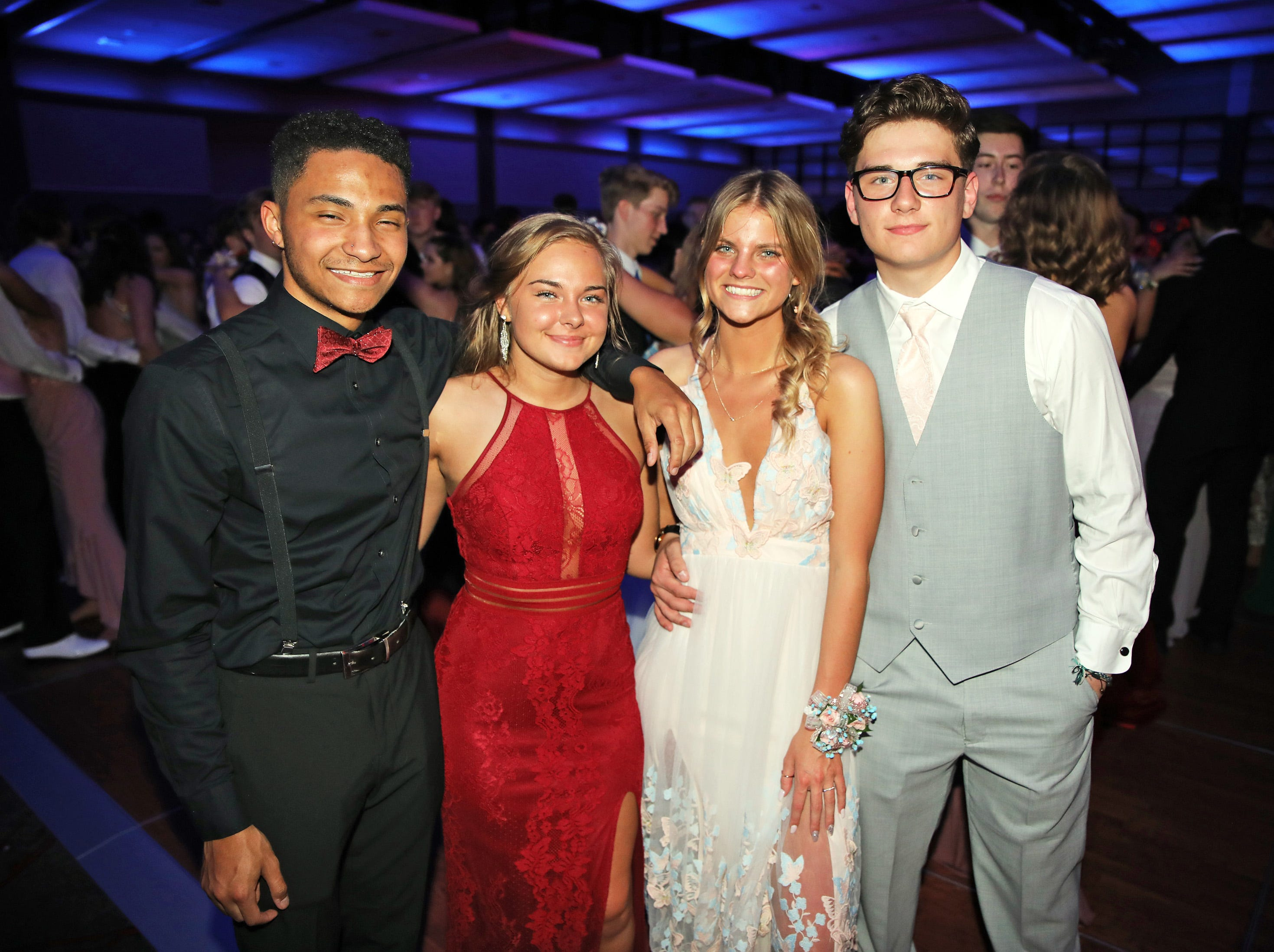 Left to right: Chaise Russell, Alyssa Vander Vorst, Breanna Girard, and Chance Palmer enjoy the Waukee High School Prom at the Ron Pearson Center in West Des Moines on Saturday, April 6, 2019.