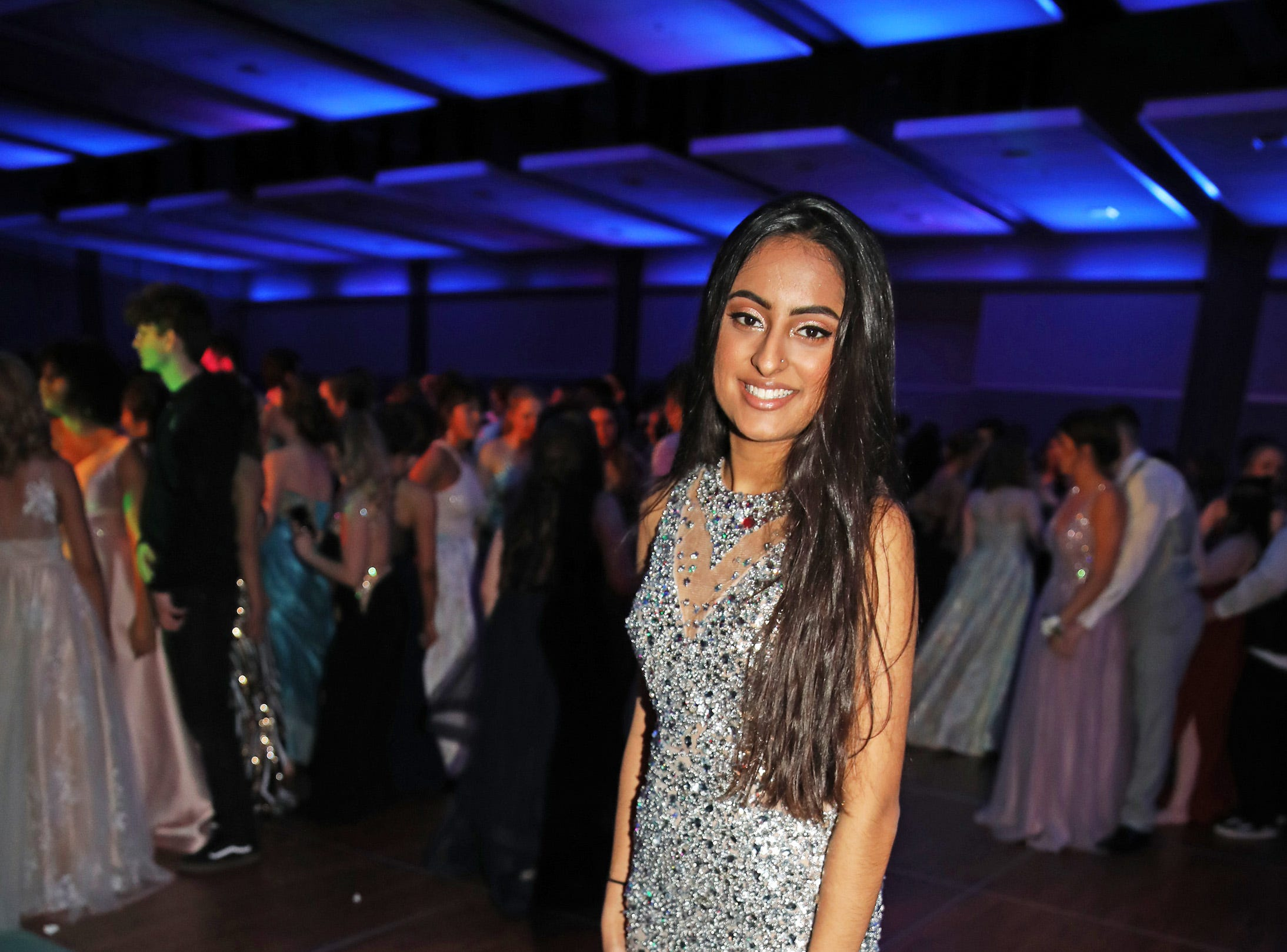 Junior Harkiran Ballagan heads to the dance floor at the Waukee High School Prom at the Ron Pearson Center in West Des Moines on Saturday, April 6, 2019.