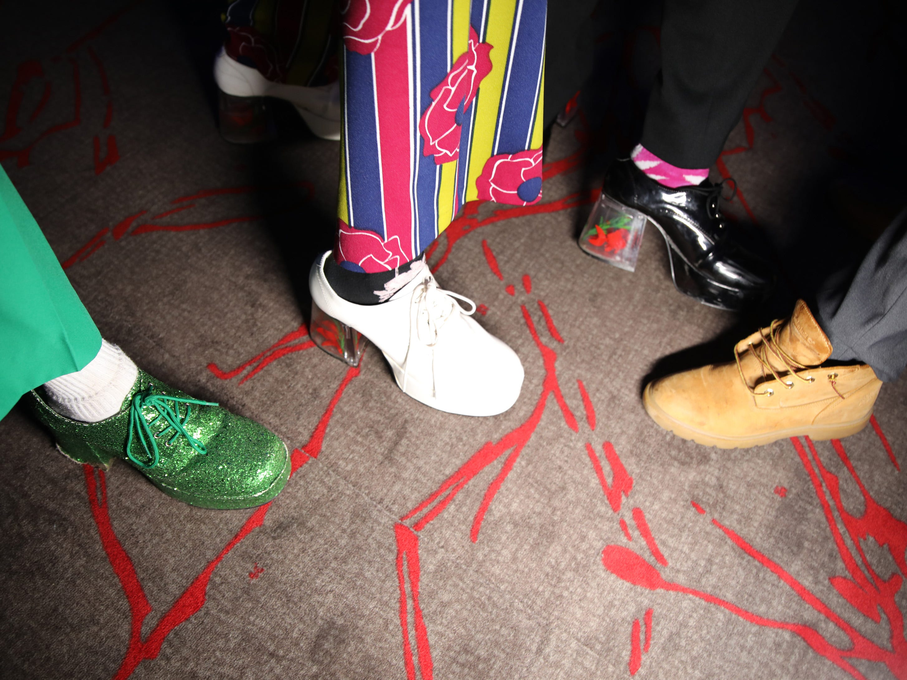 The stylish footware of Jaedon Warren, Jack Portz, Ben Cirksena, and Joey Risola at the Waukee High School Prom at the Ron Pearson Center in West Des Moines on Saturday, April 6, 2019.