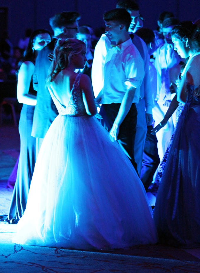 Warrior students attend the Waukee High School Prom at the Ron Pearson Center in West Des Moines on Saturday, April 6, 2019. The theme for this year's prom was Moonlight and Roses and then followed by a tropical-themed Waukiki After Prom from 11 p.m. to 5 a.m.