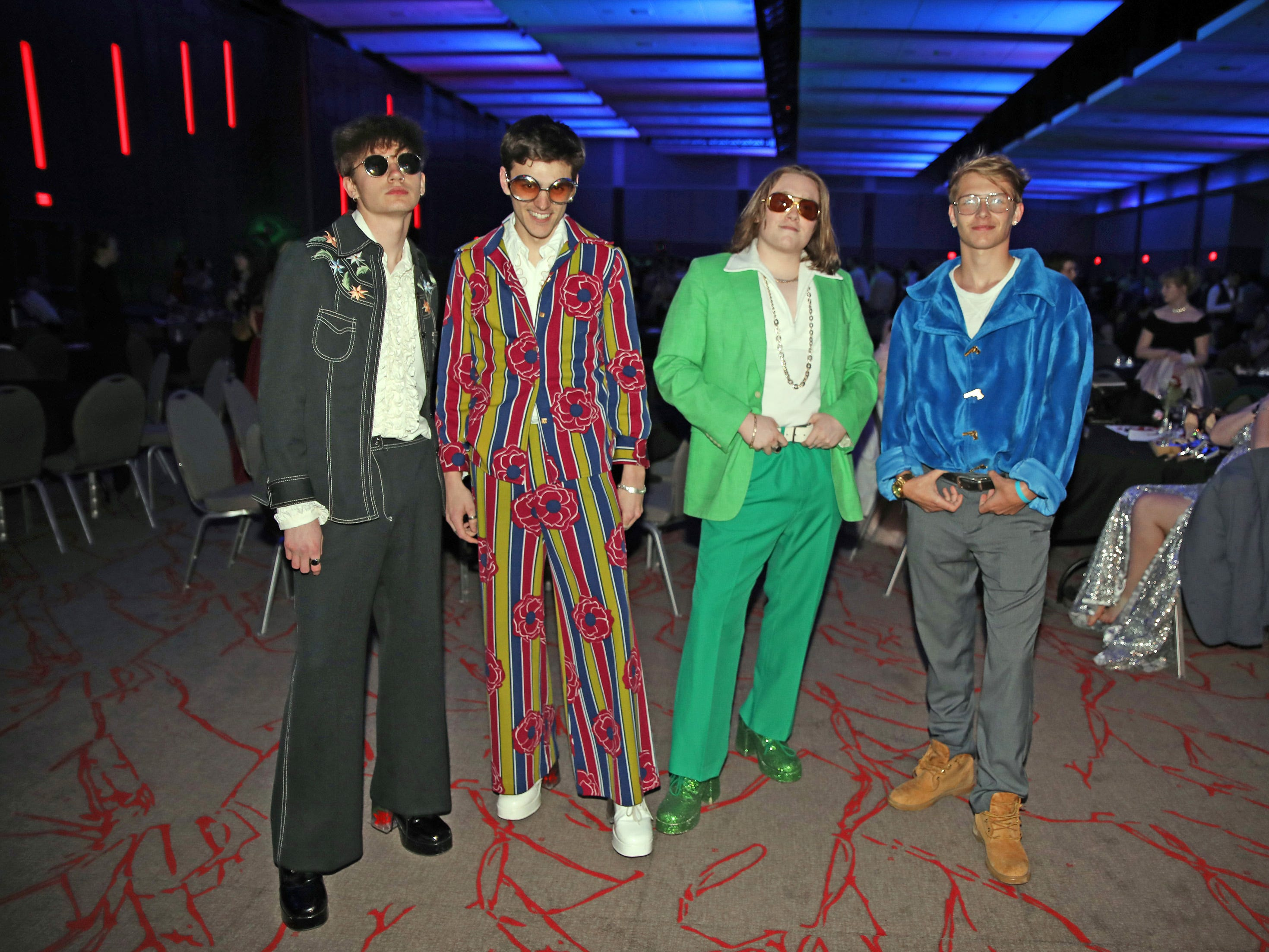 Left to right: Jaedon Warren, Jack Portz, Ben Cirksena, and Joey Risola bring the 1970s back to the Waukee High School Prom at the Ron Pearson Center in West Des Moines on Saturday, April 6, 2019. The theme for this year's prom was Moonlight and Roses and then followed by a tropical-themed Waukiki After Prom from 11 p.m. to 5 a.m.