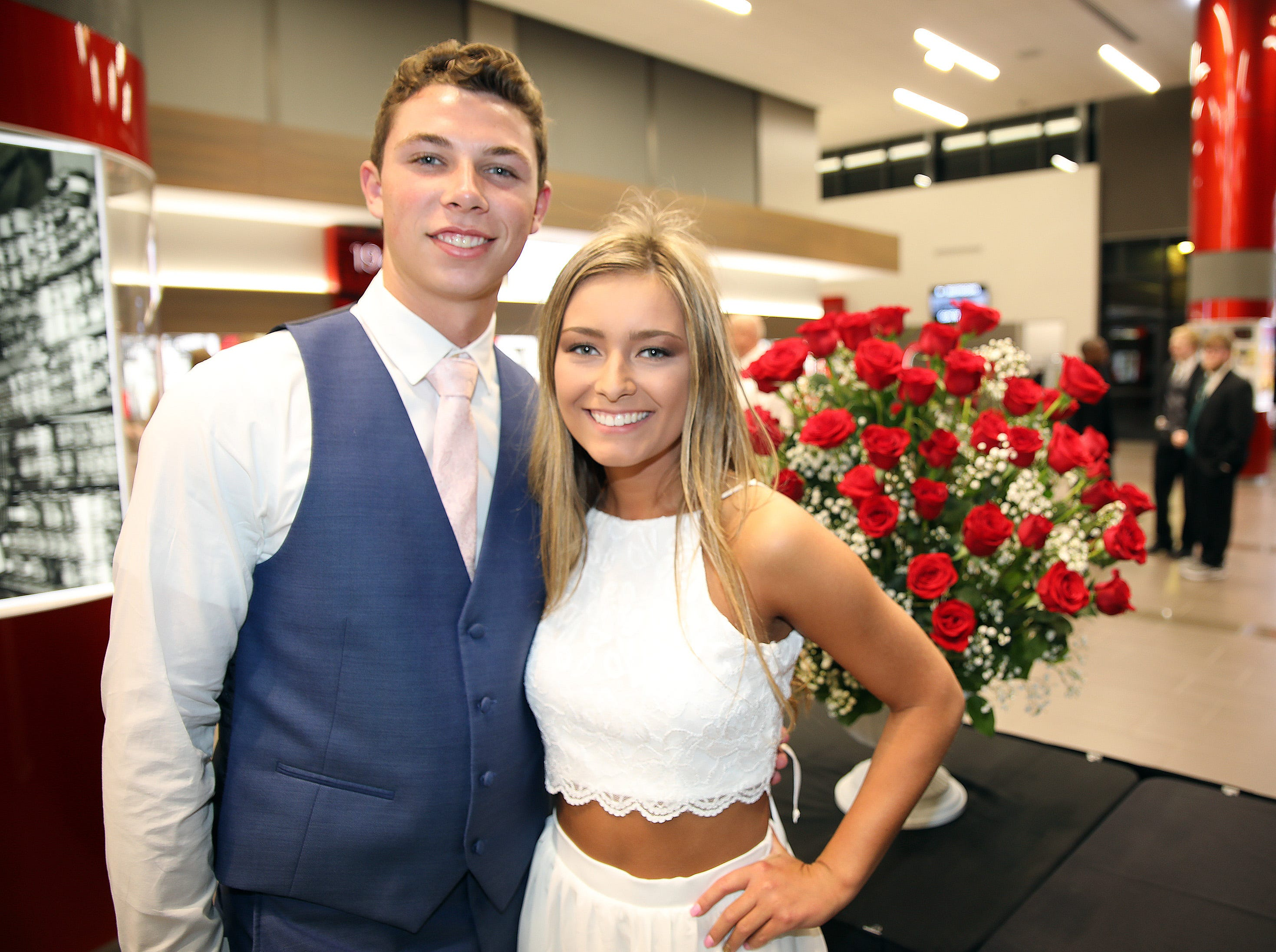 Seniors Zach Eaton and Steph Whitsell attend the Waukee High School Prom at the Ron Pearson Center in West Des Moines on Saturday, April 6, 2019. The theme for this year's prom was Moonlight and Roses and then followed by a tropical-themed Waukiki After Prom from 11 p.m. to 5 a.m.