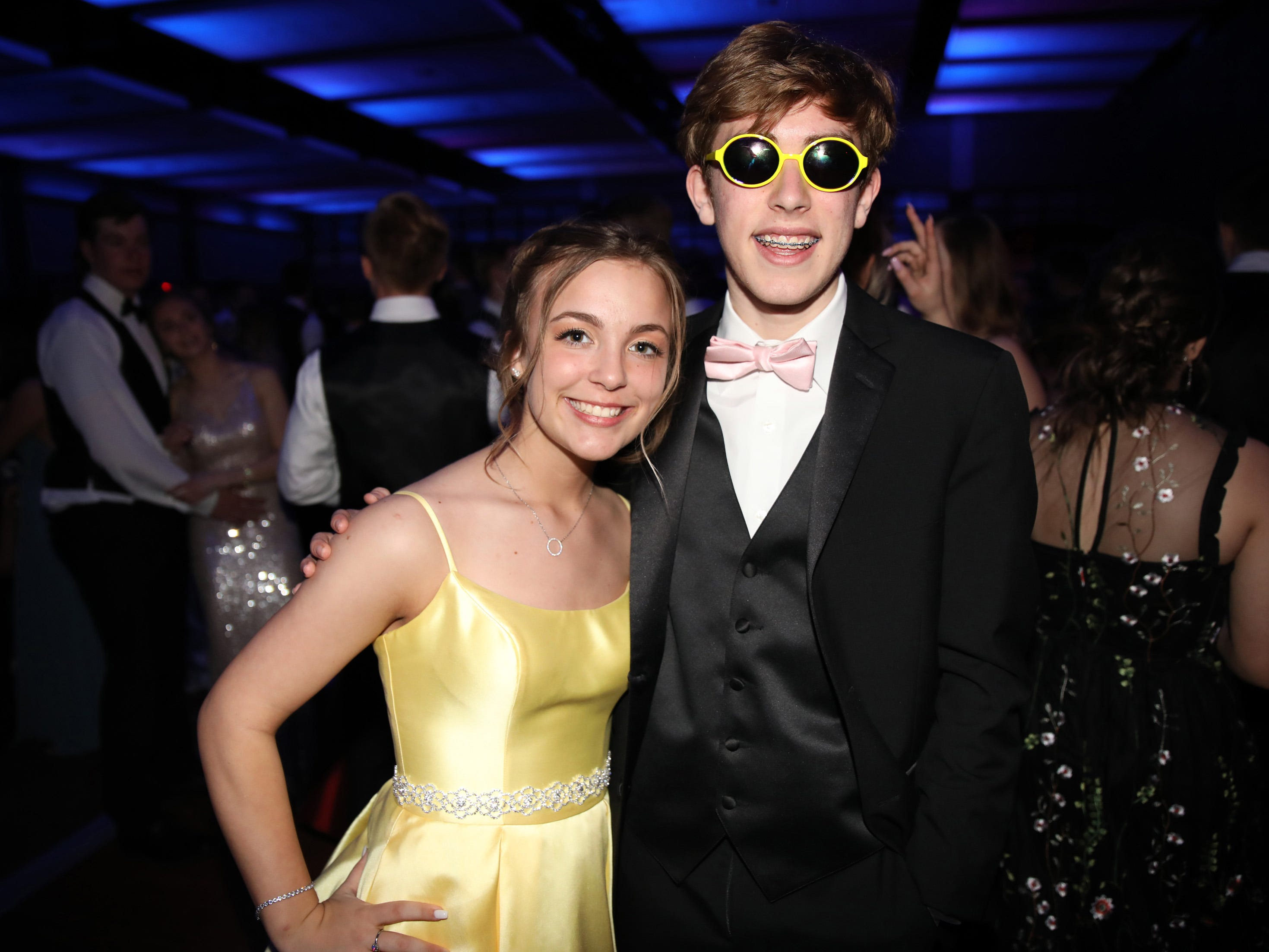 Desiree Foster and Colin McBride have fun at the Waukee High School Prom at the Ron Pearson Center in West Des Moines on Saturday, April 6, 2019.