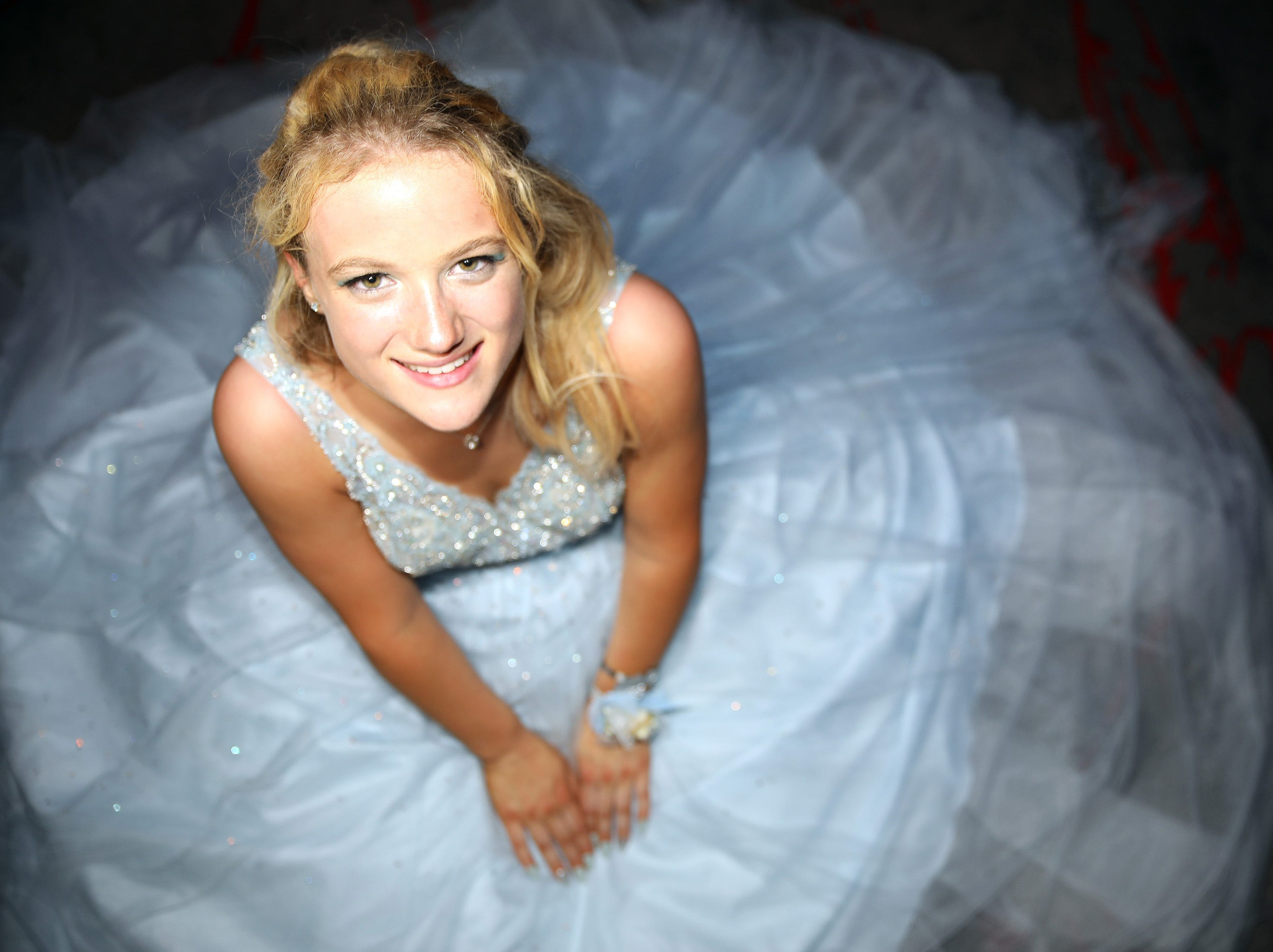 Junior Lexi Hubert sits for a portrait during the Waukee High School Prom at the Ron Pearson Center in West Des Moines on Saturday, April 6, 2019.