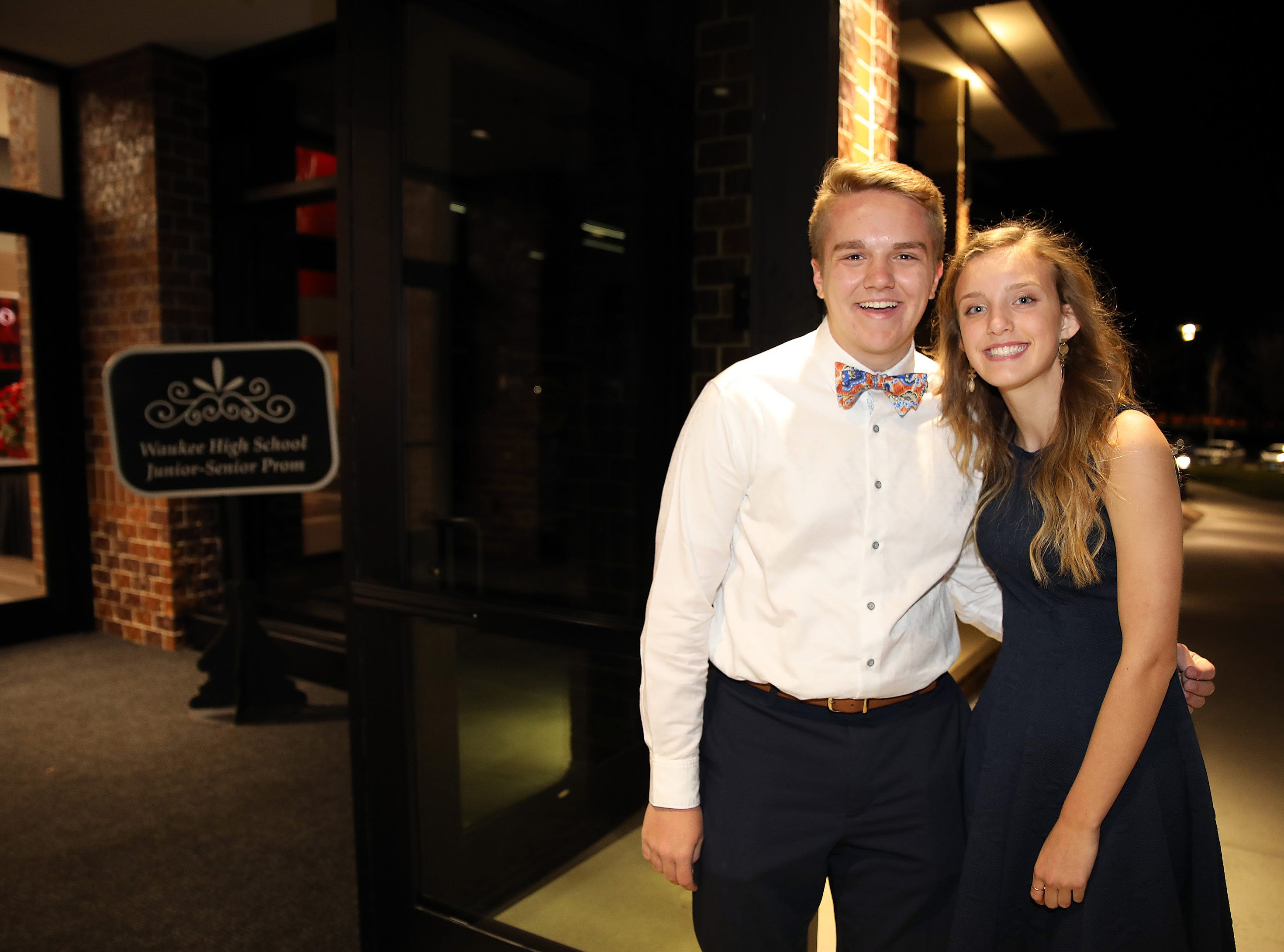 Sophomore greeters Will Reiser and Abby Cook welcome their fellow classmates to the Waukee High School Junior/Senior Prom at the Ron Pearson Center in West Des Moines on Saturday, April 6, 2019.
