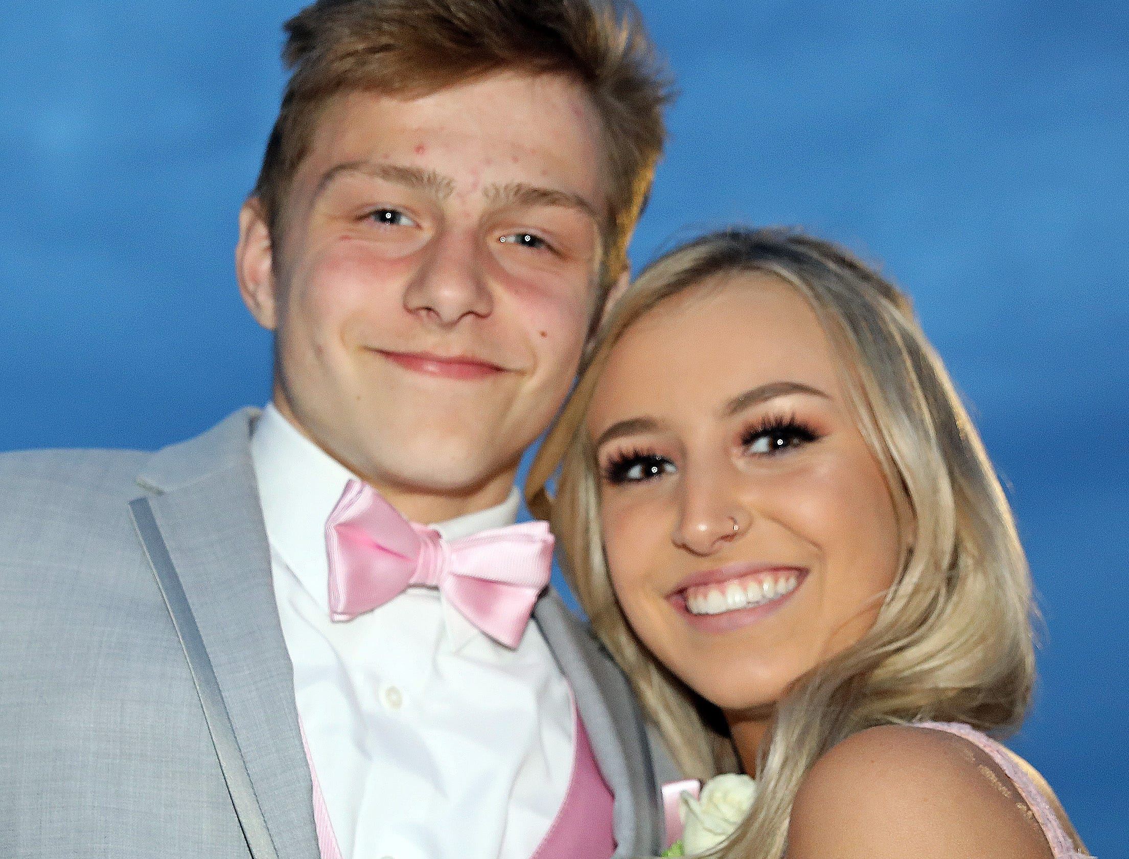 Junior Edi Cokovic and senior Georgia Bell arrive at the Waukee High School Prom at the Ron Pearson Center in West Des Moines on Saturday, April 6, 2019.
