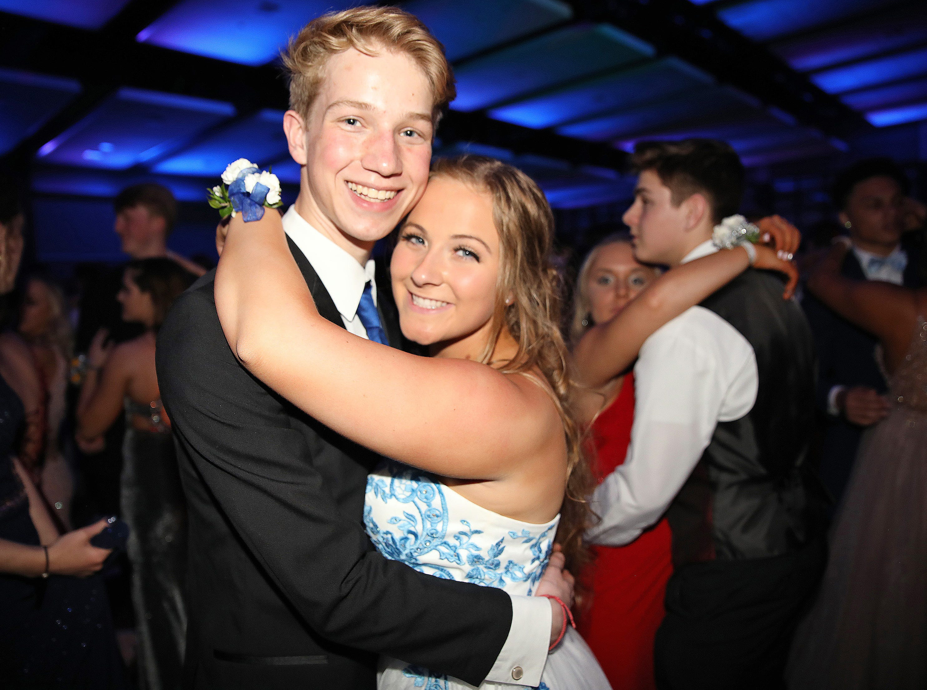 Parker Meier and Lucy Leinen enjoy dancing at the Waukee High School Prom at the Ron Pearson Center in West Des Moines on Saturday, April 6, 2019.