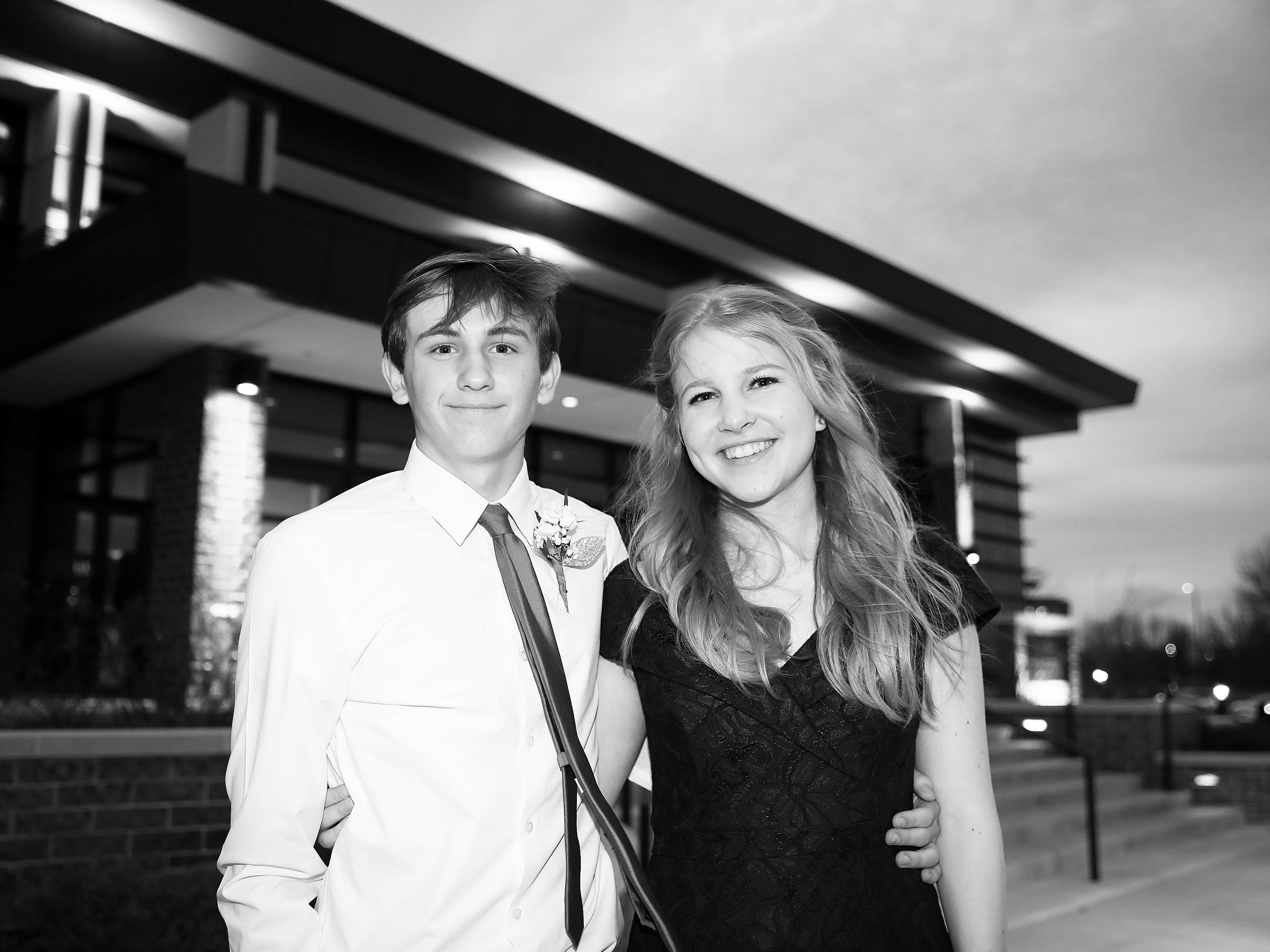 Junior Drew Pietig and sophomore Audra Wilkinson arrive at the Waukee High School Prom at the Ron Pearson Center in West Des Moines on Saturday, April 6, 2019.