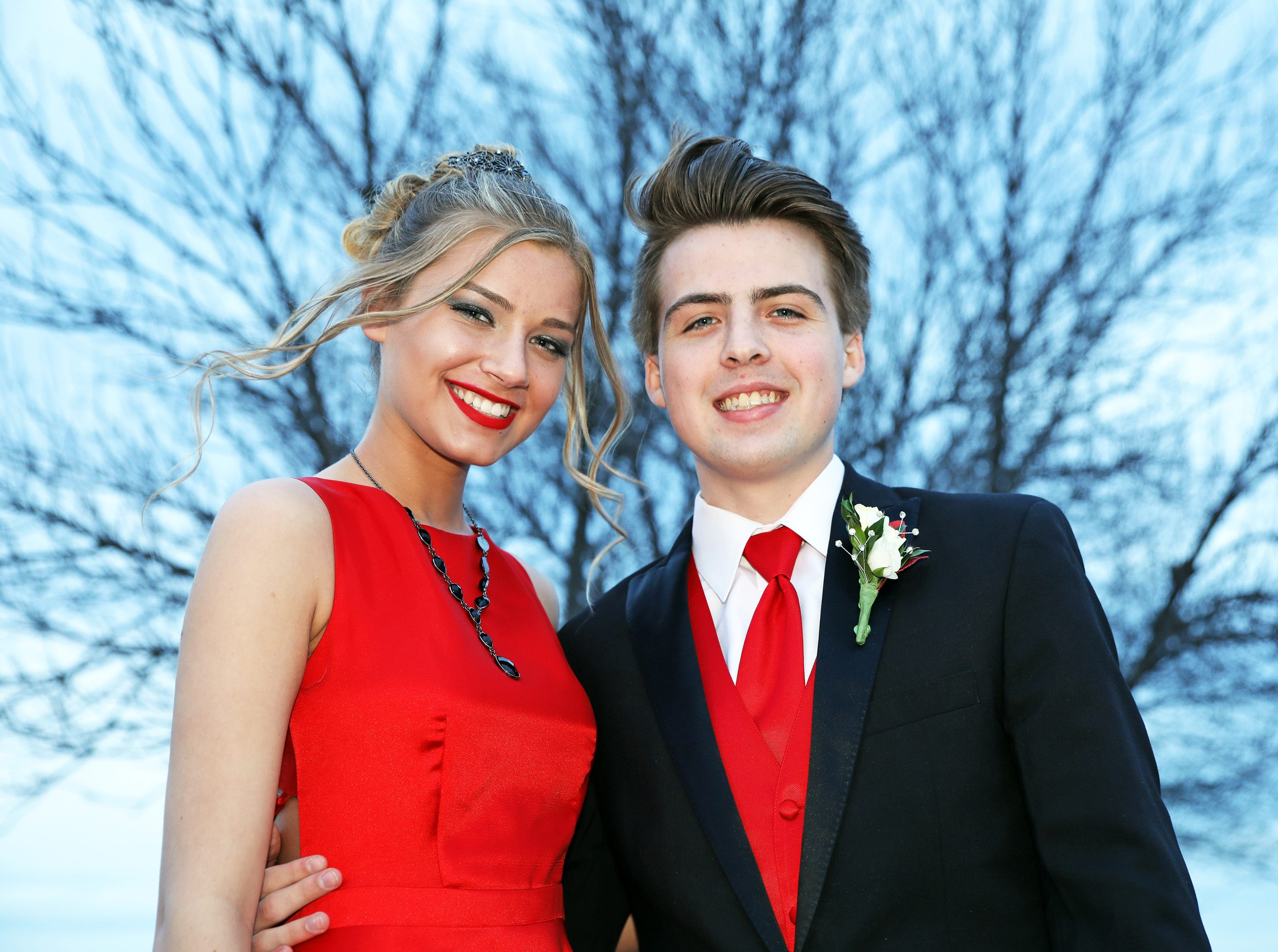 Junior Aleea Doerr and senior Jacob Best arrive at the Waukee High School Prom at the Ron Pearson Center in West Des Moines on Saturday, April 6, 2019. The theme for this year's prom was Moonlight and Roses and then followed by a tropical-themed Waukiki After Prom from 11 p.m. to 5 a.m.