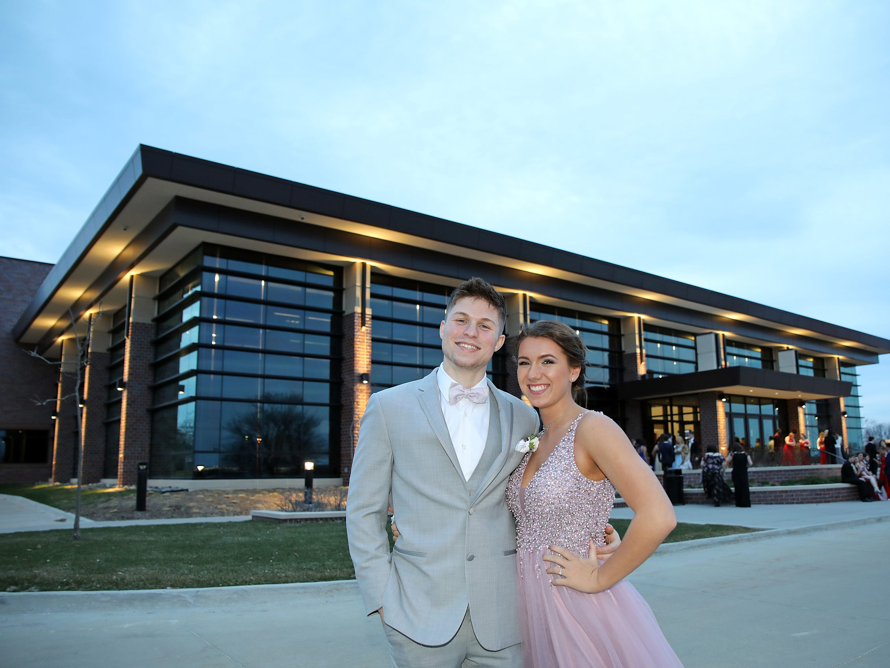 Graduate Michael Allie and junior Hailey Fielder arrive at the Waukee High School Prom at the Ron Pearson Center in West Des Moines on Saturday, April 6, 2019. The theme for this year's prom was Moonlight and Roses and then followed by a tropical-themed Waukiki After Prom from 11 p.m. to 5 a.m.