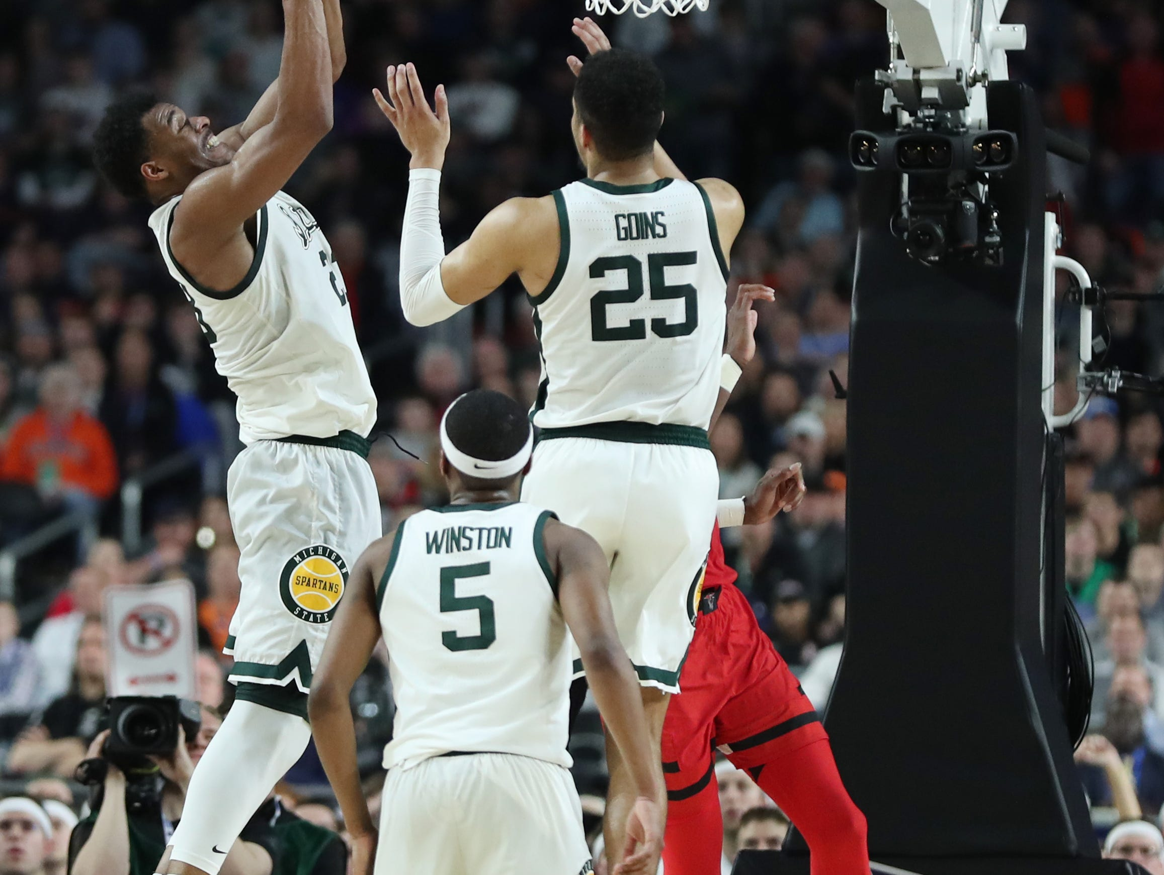 Michigan State forward Xavier Tillman (23) grabs a rebound over Texas Tech in the first half of the Spartan's Final Four game at U.S. Bank Stadium in Minneapolis, Minnesota on Saturday, April 06, 2019.