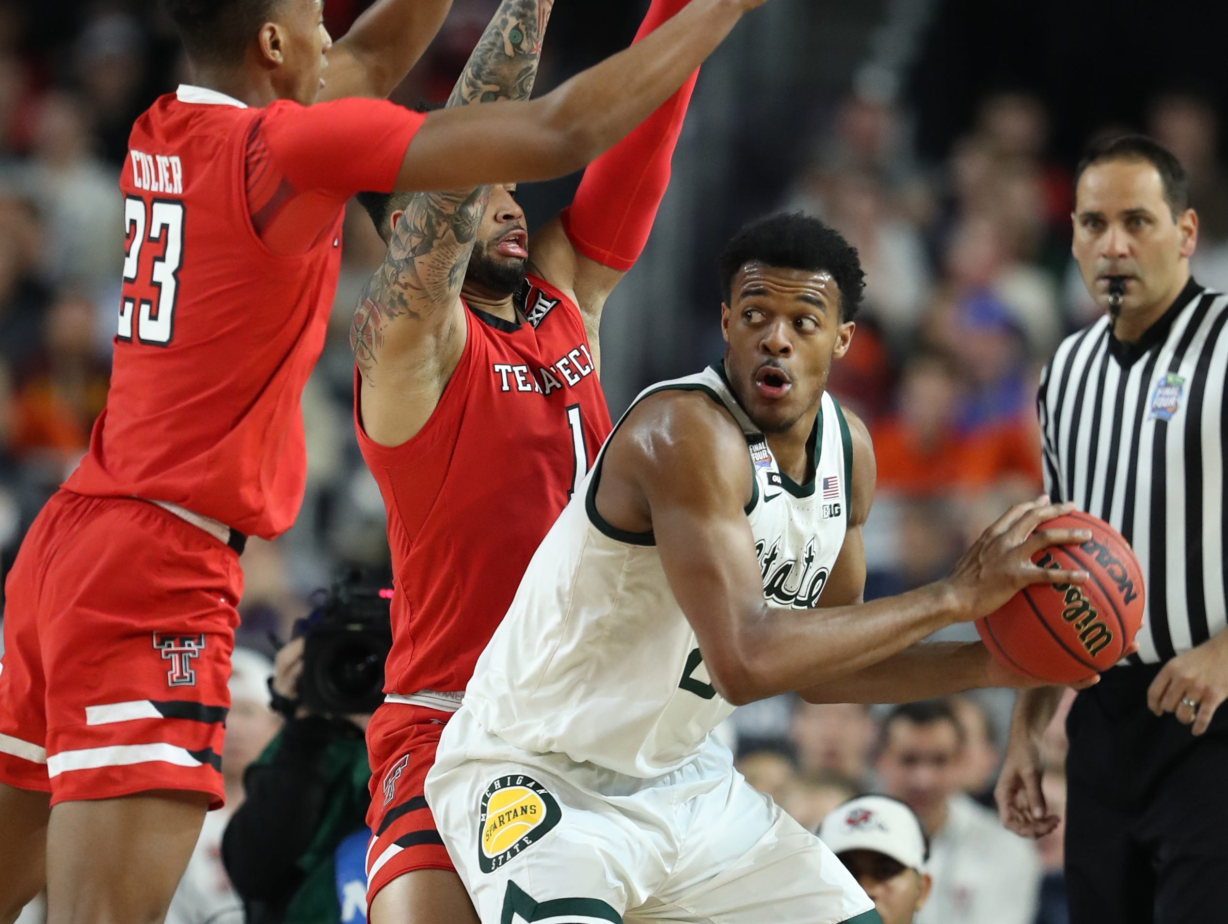 Texas Tech guard Jarrett Culver (23) and guard Brandone Francis (1) guard Michigan State forward Xavier Tillman (23) in the first half of their Final Four game at U.S. Bank Stadium in Minneapolis, Minnesota on Saturday, April 06, 2019.